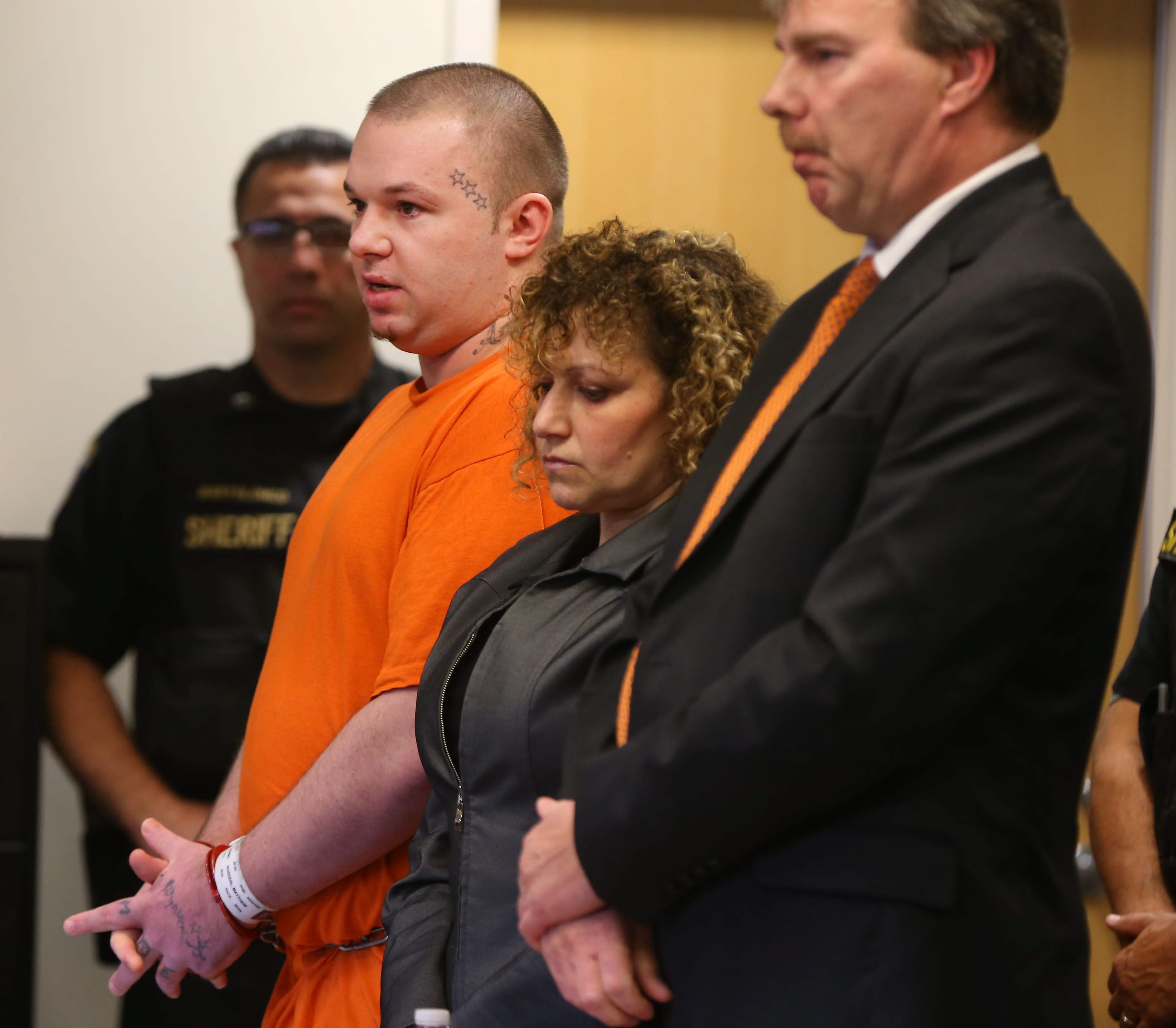 Matthew Kuzdzal speaks to the court with his attorneys Emily Trott and Robert Cutting during his sentencing in front of Judge Christopher J. Burns in Erie County Court Tuesday, October 27,  2014.  (Mark Mulville/Buffalo News)