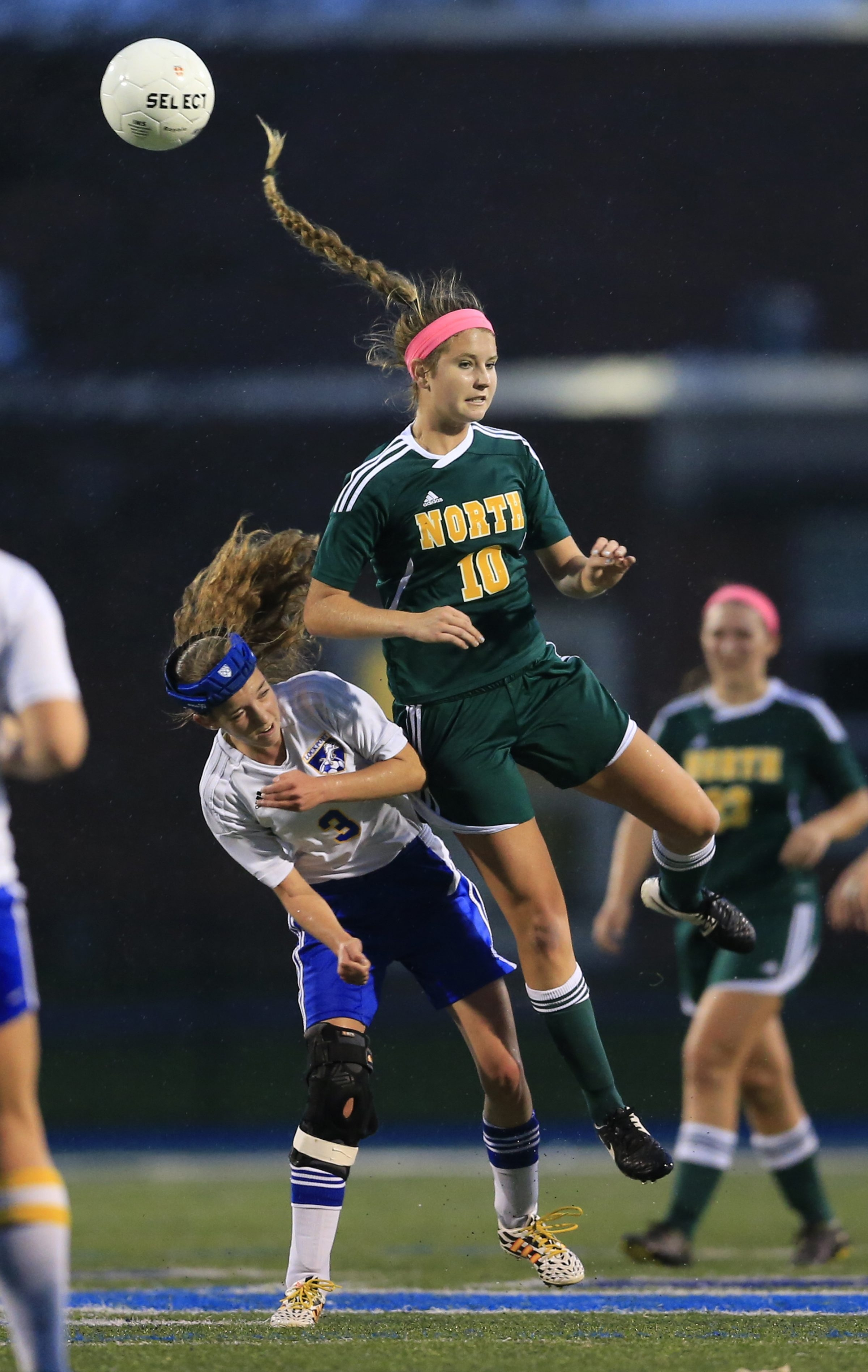 Williamsville North's Hanny Podgurski (10) and Lockport's Sage Donovan go for the ball during Tuesday's Class AA semifinal game won by the Spartans, 1-0.