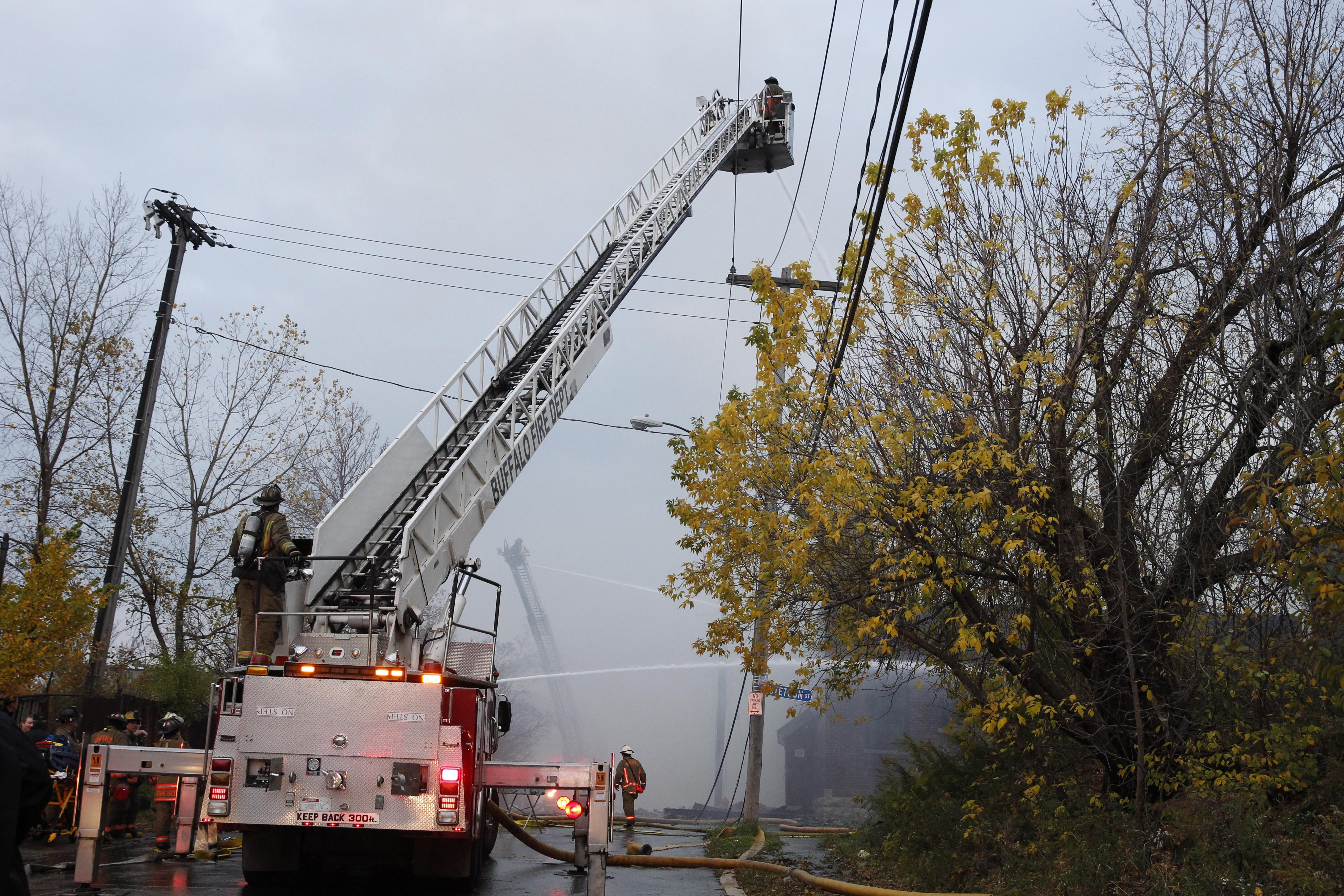Buffalo firefighters responded to a four-alarm warehouse fire at 453 Howard Street in Buffalo , Tuesday, Oct. 28, 2014.  There were no injuries as firefighters continued to fight the blaze.  Structures were damaged at 463 and 173 Metcalfe. (Sharon Cantillon/Buffalo News)