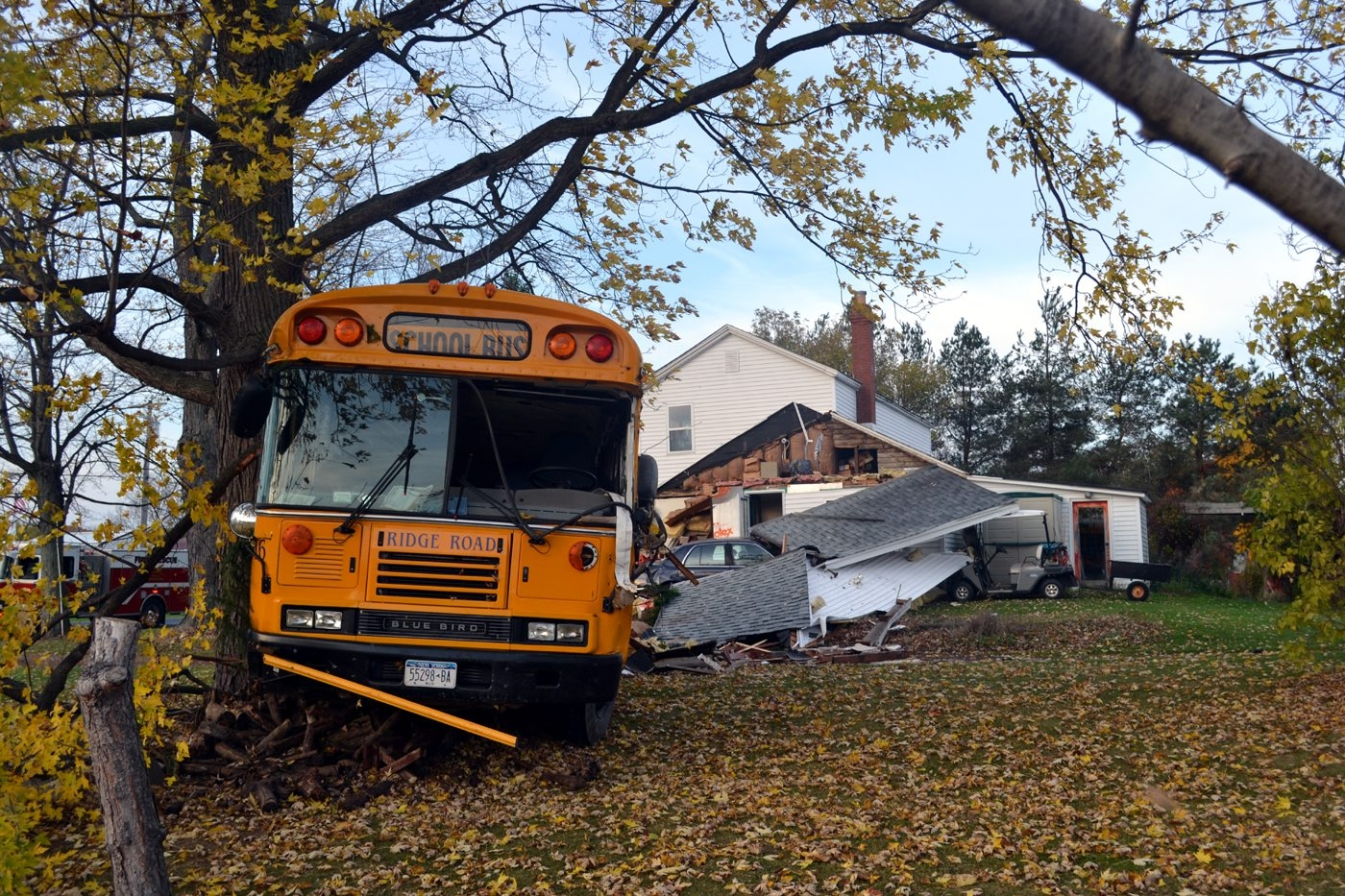 The scene on Mapleton Road in Pendleton today where a school bus crashed into a house. (Larry Kensinger/Special to The Buffalo News)