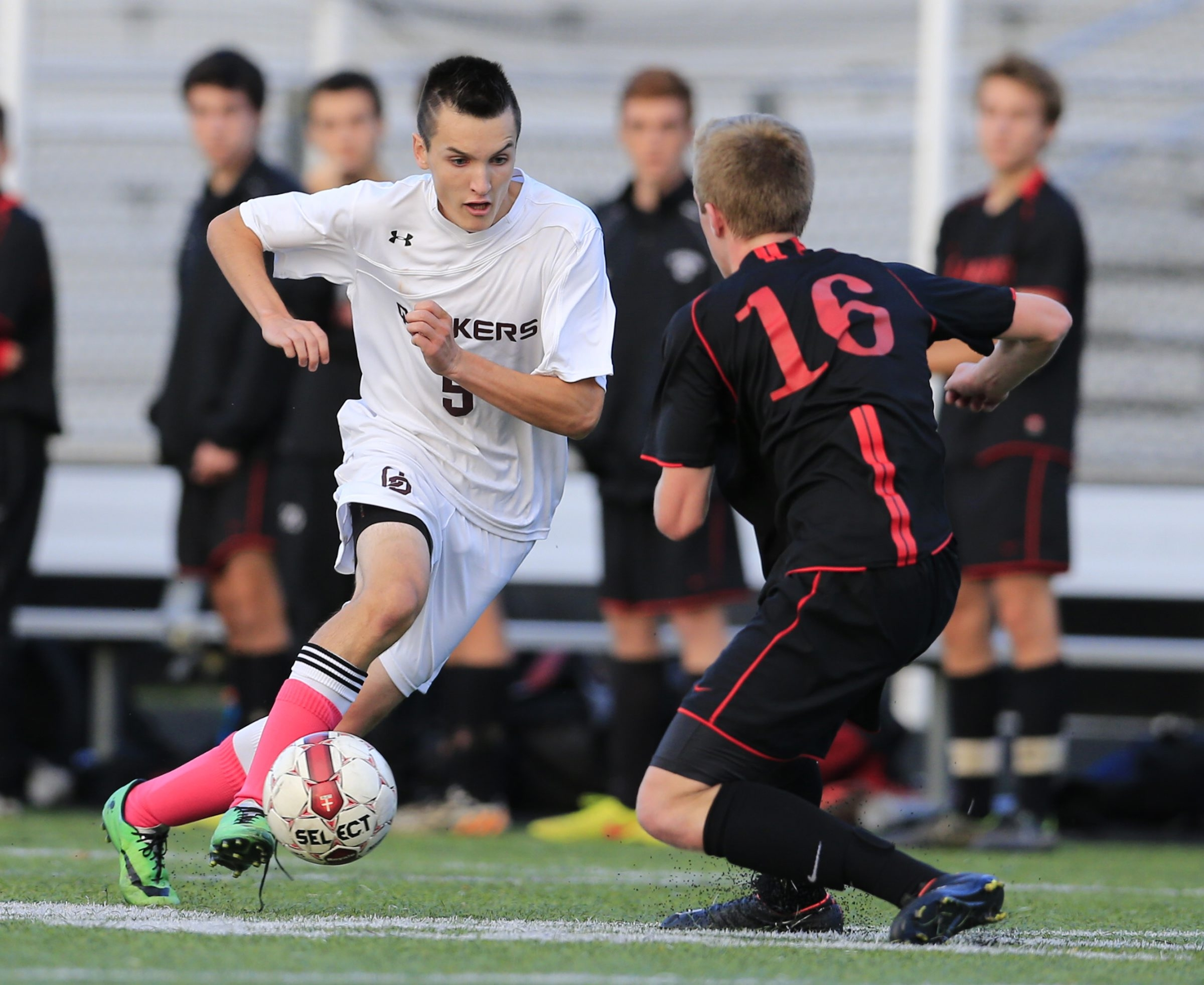 Orchard Park's Ryan McMaster (5) moves the ball against Clarence's Sean Palmer during the Quakers' 3-0 victory in the Class AA boys soccer semifinal at Hamburg.