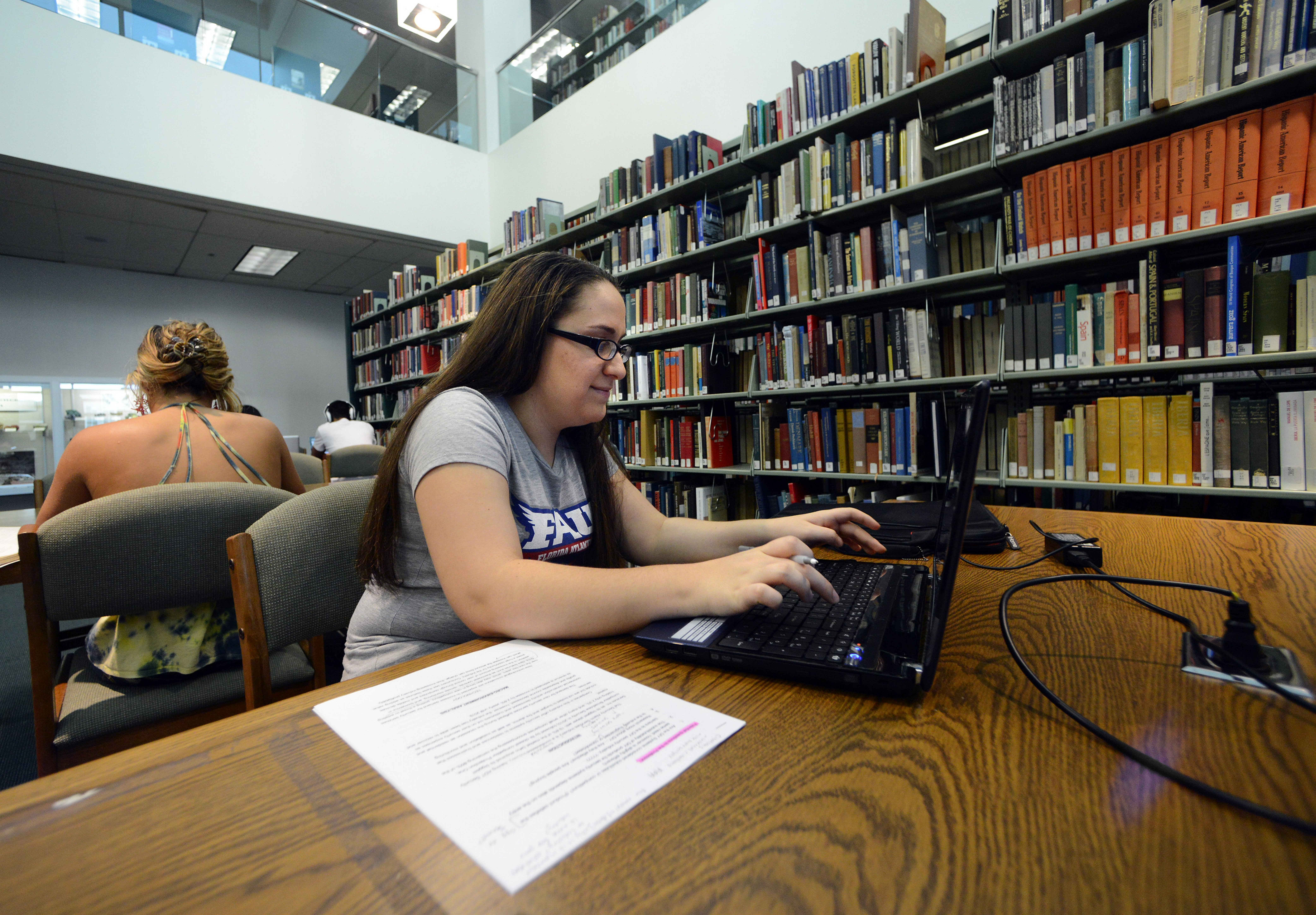 Tara Wengert, 21, of Tamarac, Fla., works on a class project at the S.E. Wimberly Library in Boca Raton, Fla. Wengert is a senior at Florida Atlantic University where she is majoring in hospitality management while working part time.