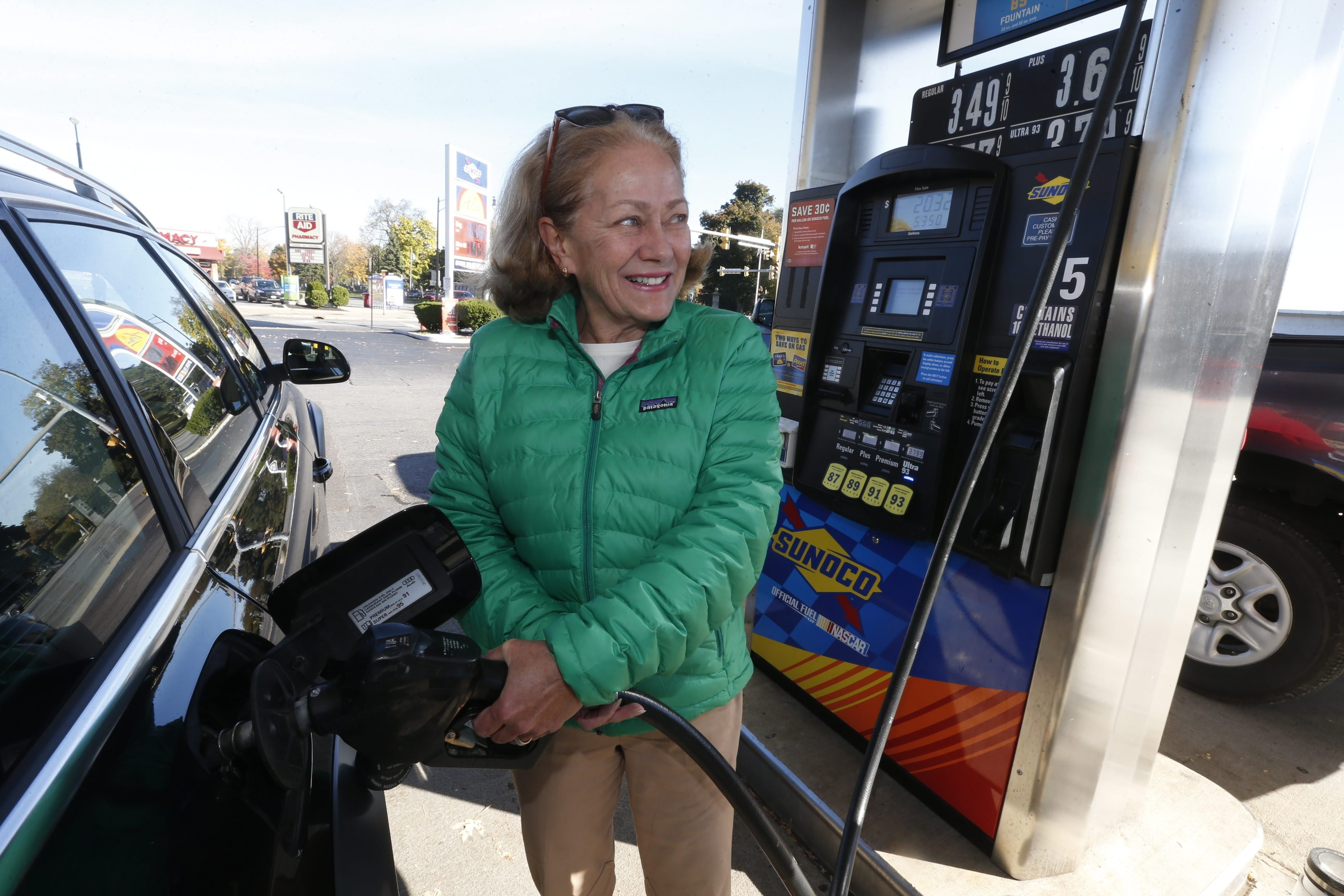 Pamela Righter of Buffalo pumps gas at the Sunoco station on Delaware Avenue near Gates Circle on Monday.
