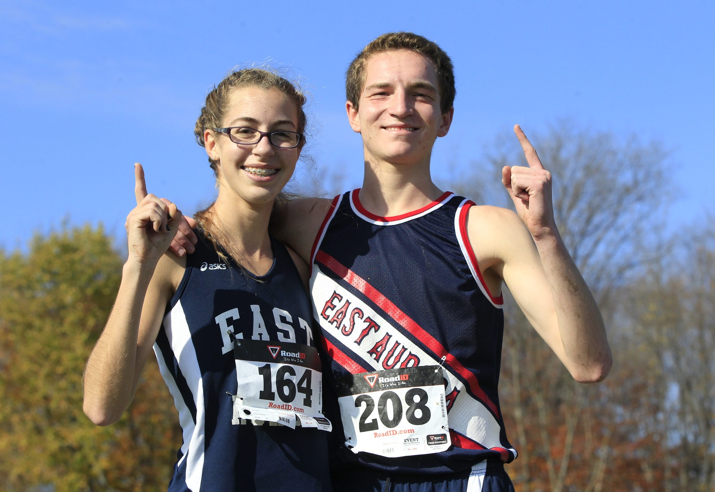 Winners of the ECIC cross country meet from East Aurora are Sophia Tasselmyer and Kenny Vasbinder at East Aurora high school on Saturday, Oct. 25, 2014.