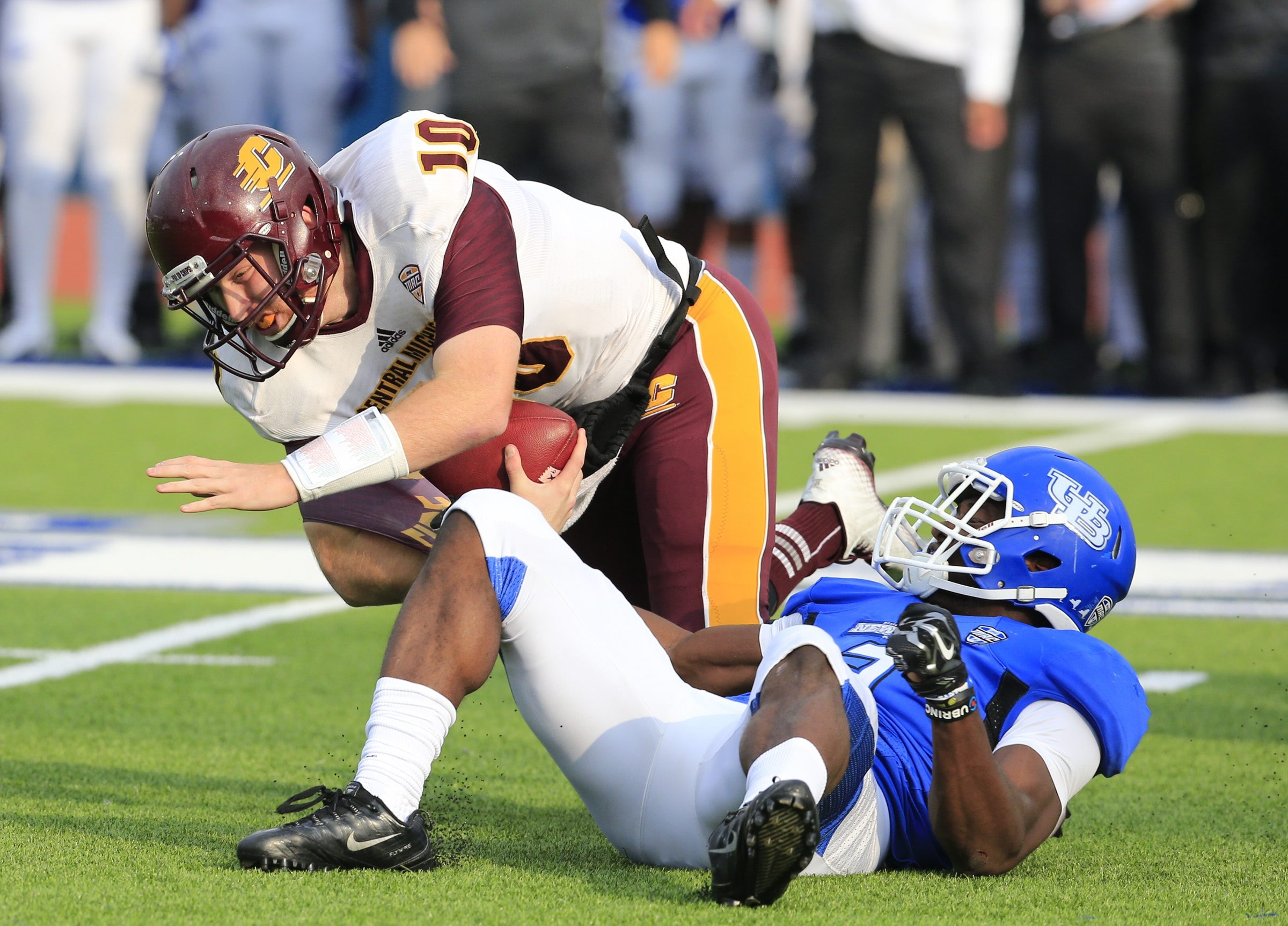 UB produced five sacks on Central Michigan quarterback Cooper Rush, including this one by Okezie Alozie.