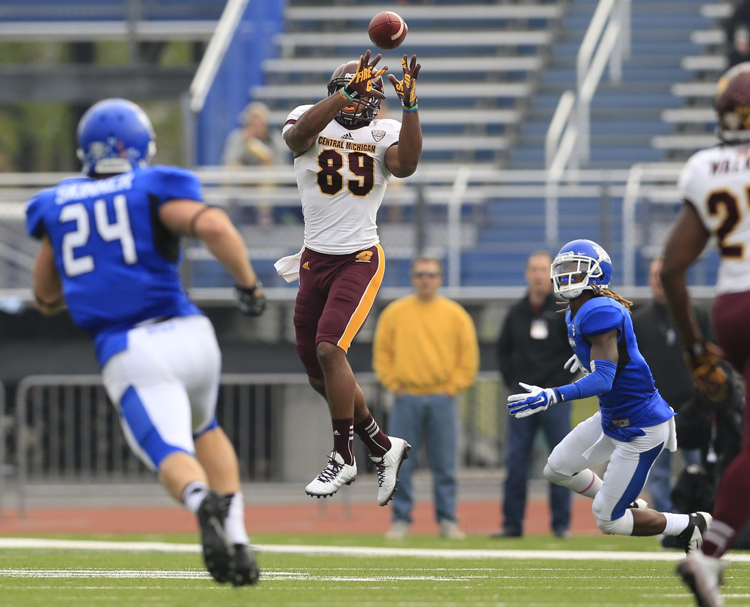 Central Michigan's Ben McCord catches a pass as UB defenders close in during first-half action at UB Stadium on Saturday.
