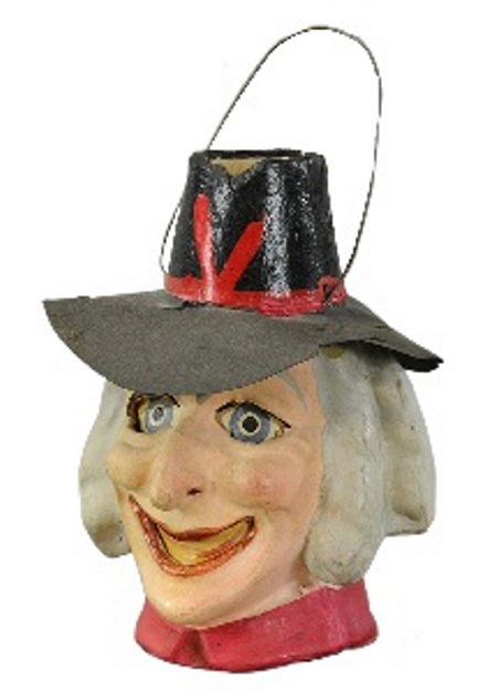 This 5-inch-tall witch-head jack-o-lantern made in Germany is probably from the 1920s. Although the paint has been touched up, it sold for $1,121 at a Bertoia auction in Vineland, N.J.