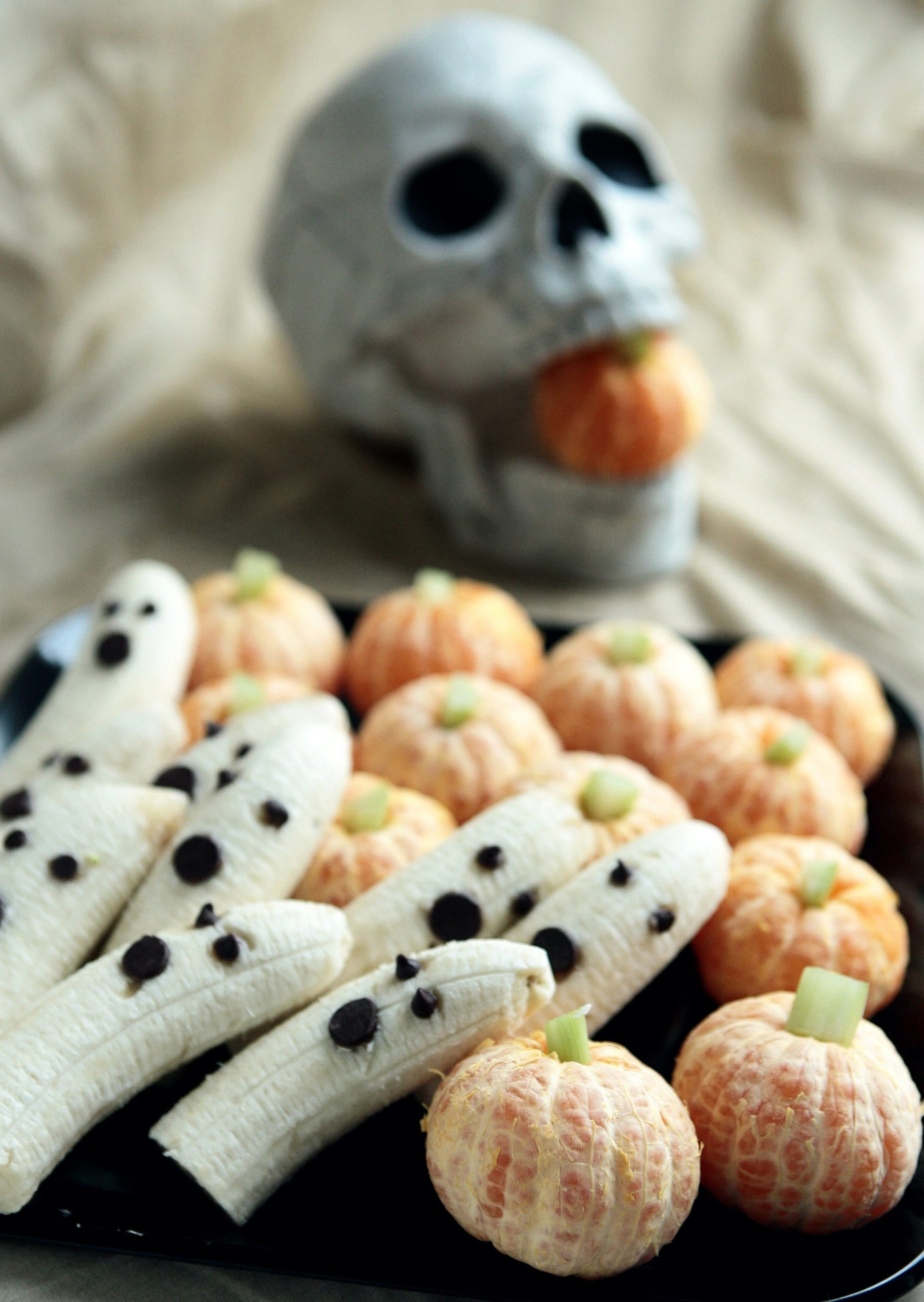 Healthy Halloween treats don't have to be boring. Ghostly bananas taste great with chocolate chip faces and pumpkins made from clementine tangerines with celery stick stems are easy to make with kids. (Hillary Levin/St. Louis Post-Dispatch/MCT)