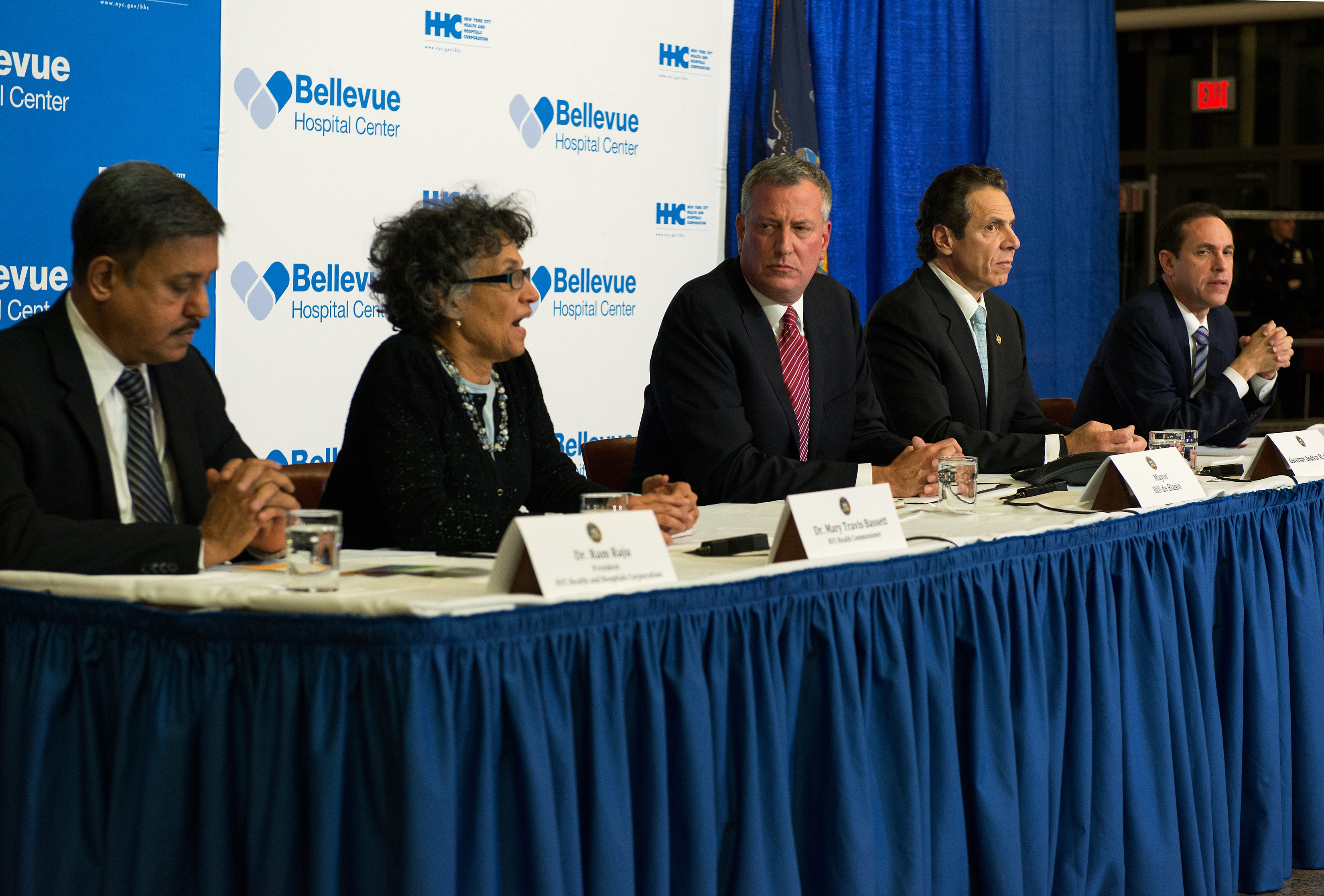 NEW YORK, NY - OCTOBER 23: (L-R) President of NYC Health and Hospitals Corporation Dr. Ram Raju, NYC Health Commissioner Dr. Mary Travis Bassett, Mayor Bill DeBlasio of New York City, Governor Andrew Cuomo of New York and Acting Commissioner of the Department of Health Dr. Howard Zucker speak at a press conference October 23, 2014 in New York City. The conference addressed Dr. Craig Spencer, who had returned to New York City from Guinea where he was working with Doctors Without Borders treating Ebola patients. Spencer had been quarantined after showing symptoms consistent with the virus and was taken to Bellevue hospital to undergo testing. According to reports, test results have confirmed that Spencer has contracted the Ebola virus. (Photo by Bryan Thomas/Getty Images)