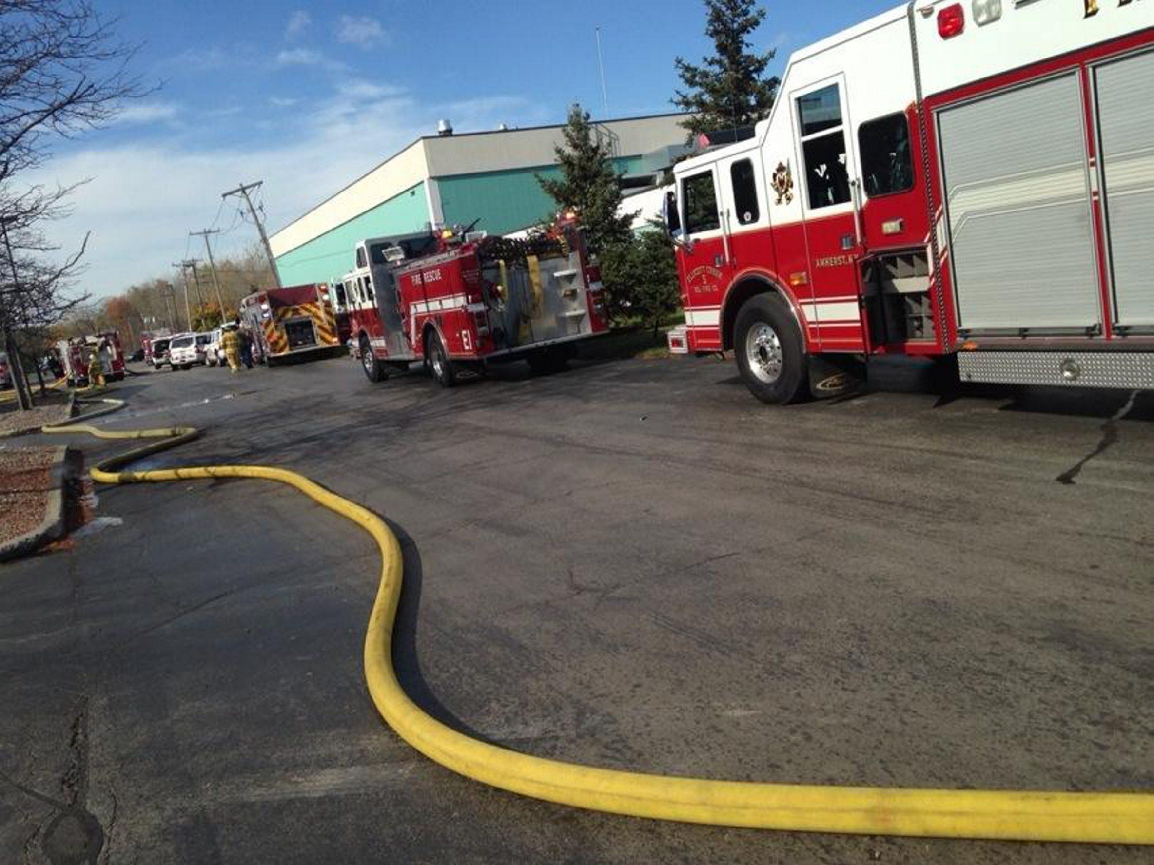 Fire crews on the scene at iimak at John Glenn Drive. (Robert Kirkham/Buffalo News)