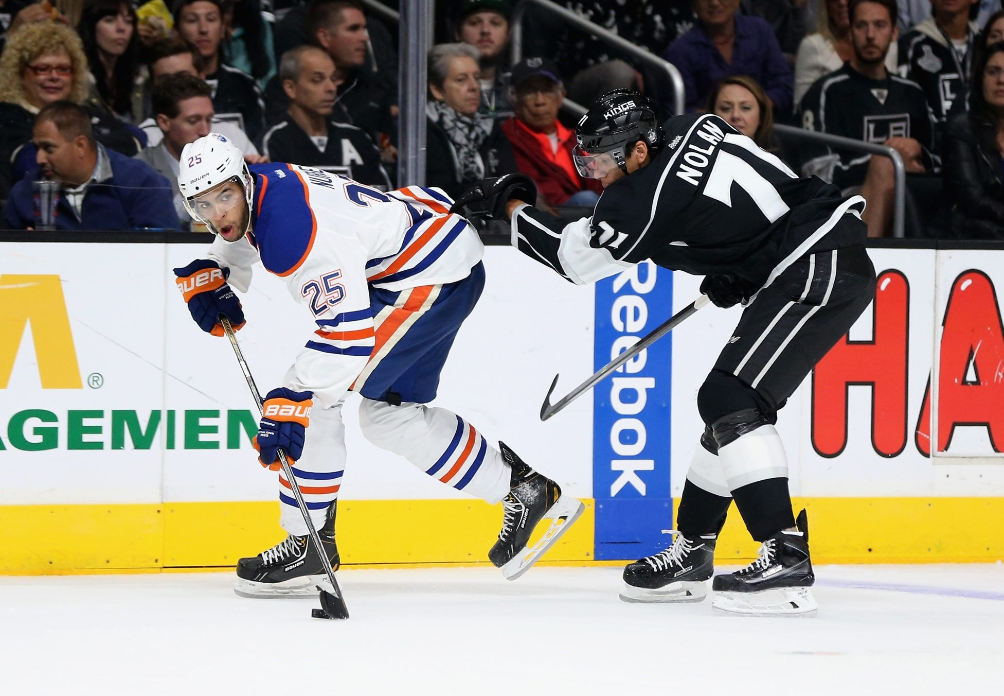 Jordan Nolan of the Kings, right, playing against Edmonton's Darnell Nurse, says he works harder when his father, Sabres coach Ted Nolan, is in the same building.