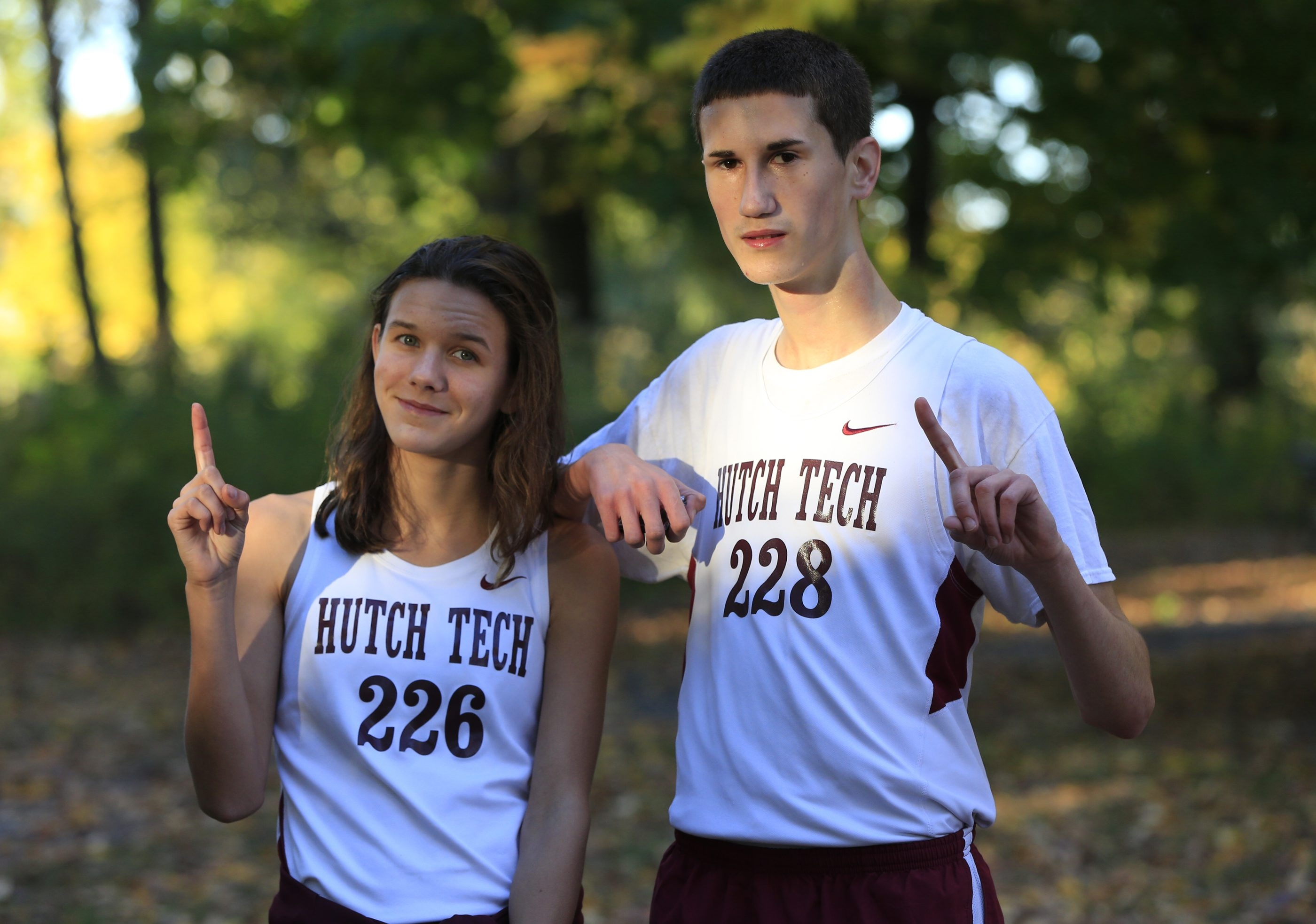 Emily Booth and Njegos Petrovic of Hutch Tech won individual cross country titles.