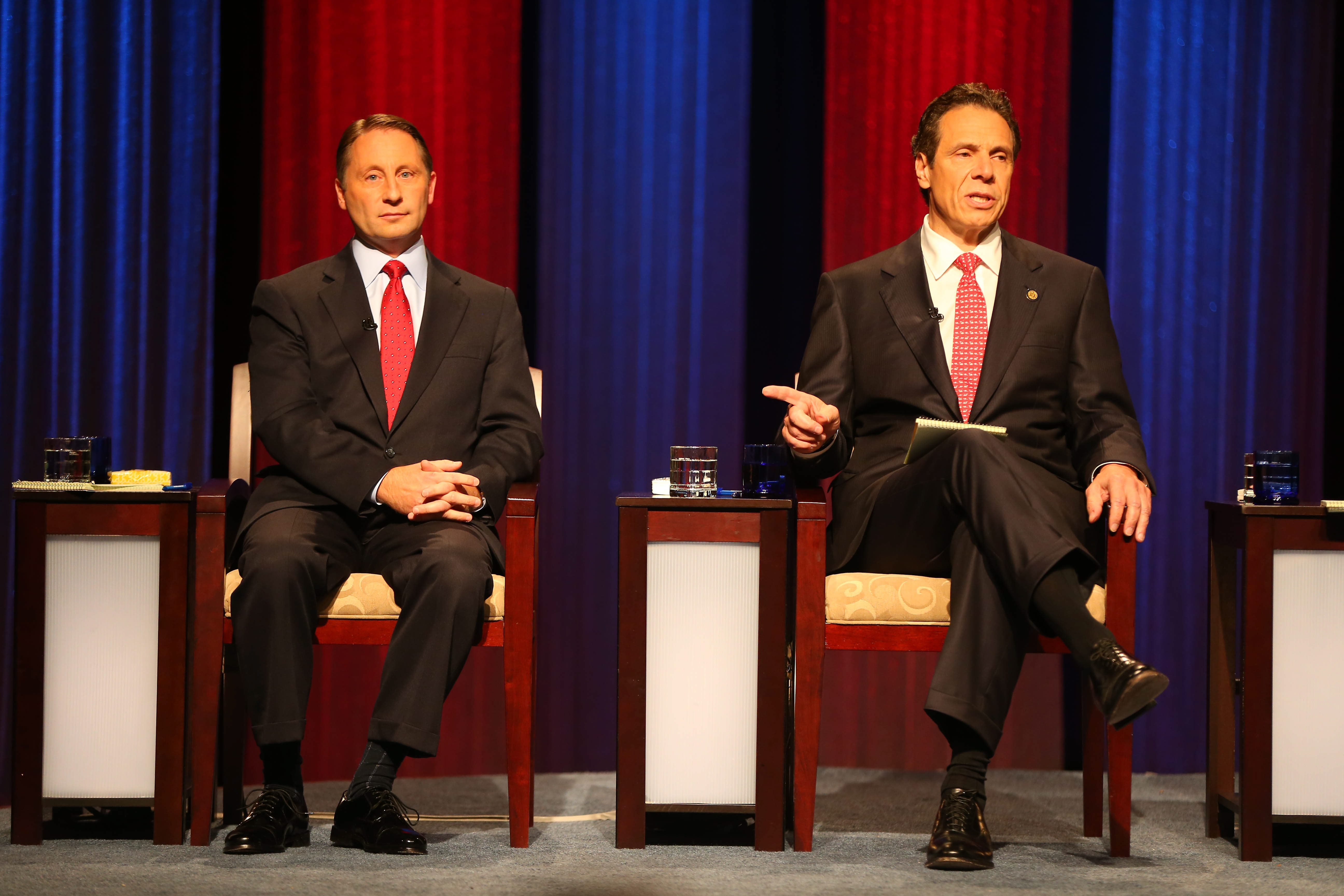 New York gubernatorial candidate Rob Astorino listens as Gov. Andrew Cuomo answers a question during a debate sponsored by WNED-WBFO and The Buffalo News at WNED studios in Buffalo, N.Y. Wednesday, Oct. 22, 2014.  (Mark Mulville/Buffalo News)