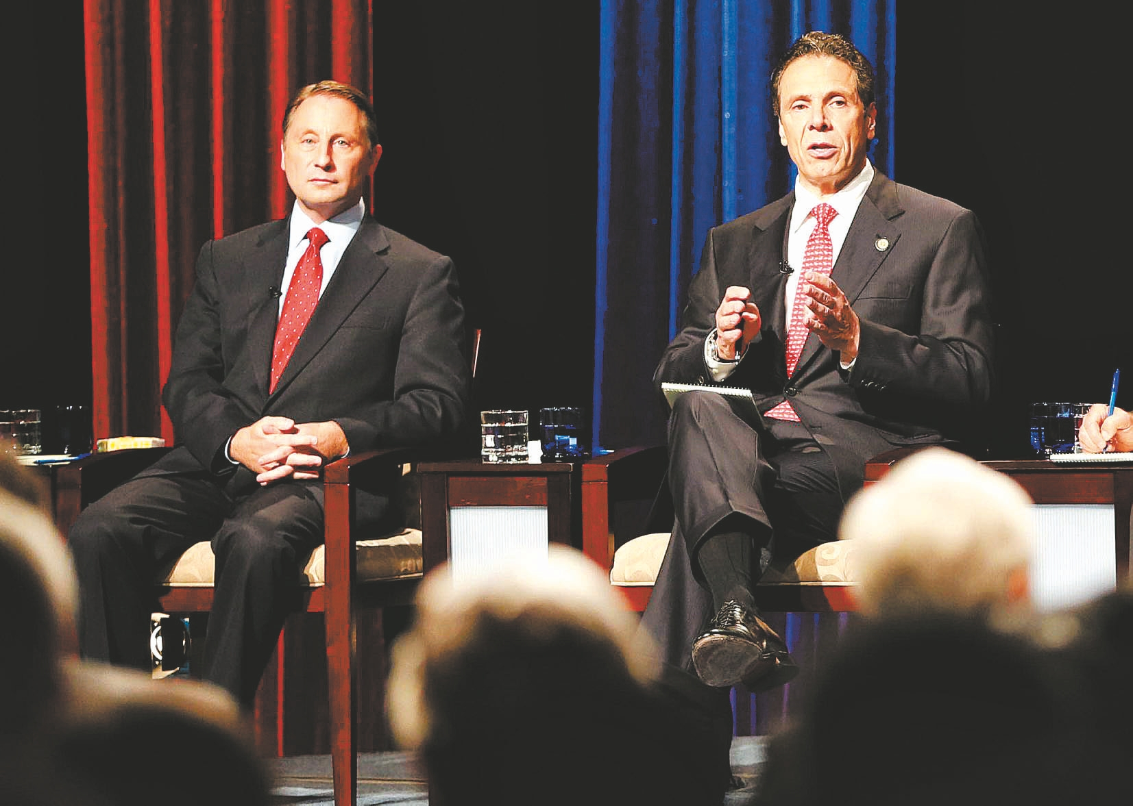 Democratic Gov. Andrew M. Cuomo gets a turn to air his views as Republican rival Rob Astorino listens in Wednesday night's debate at WNED-TV, where participants also included Howie Hawkins of the Green Party and Libertarian candidate Michael McDermott.
