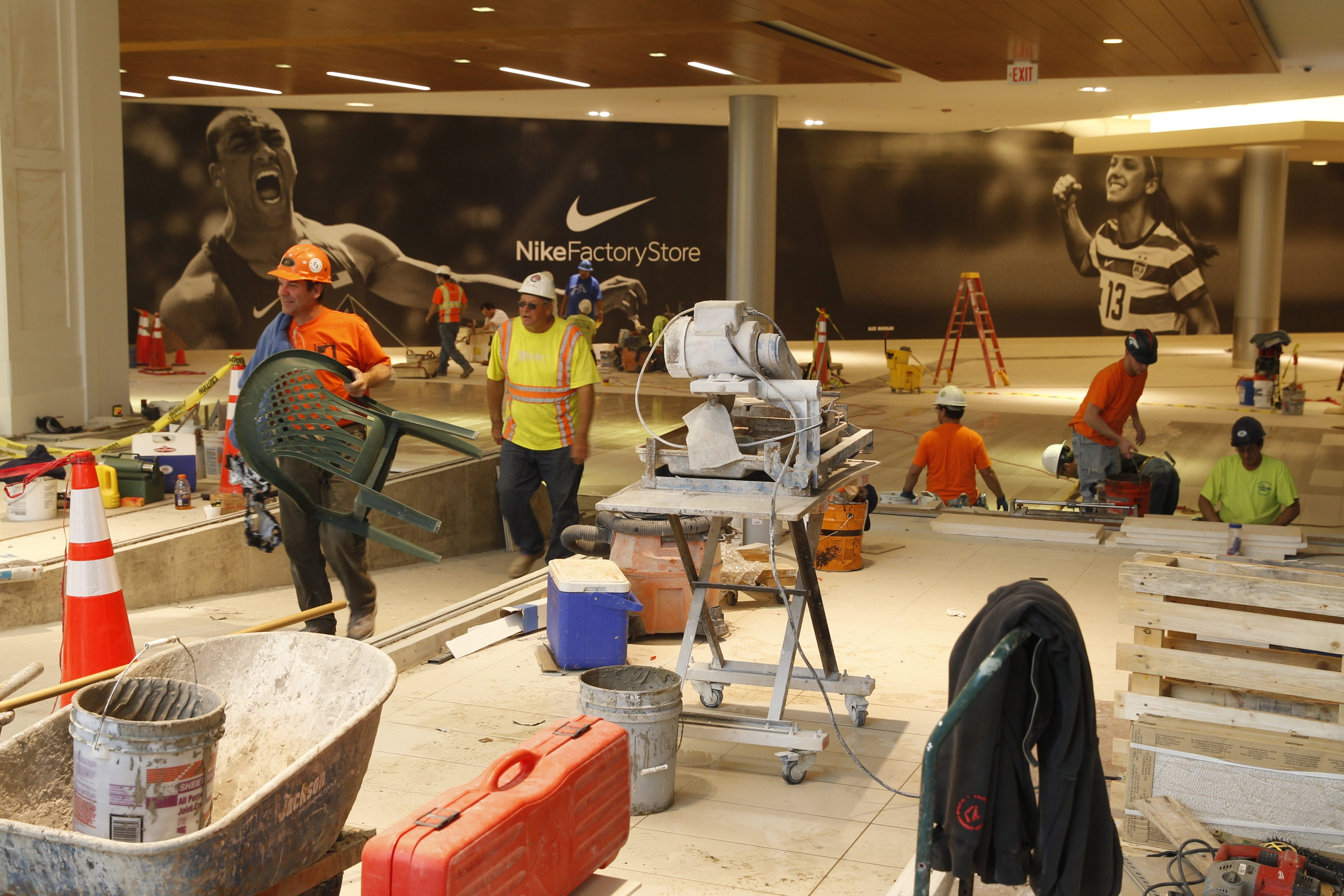 Work on flooring continued Wednesday in the new wing of the $71 million expansion at the Fashion Outlets in Niagara Falls in preparation for today's opening of more than 30 new stores. (John Hickey/Buffalo News)