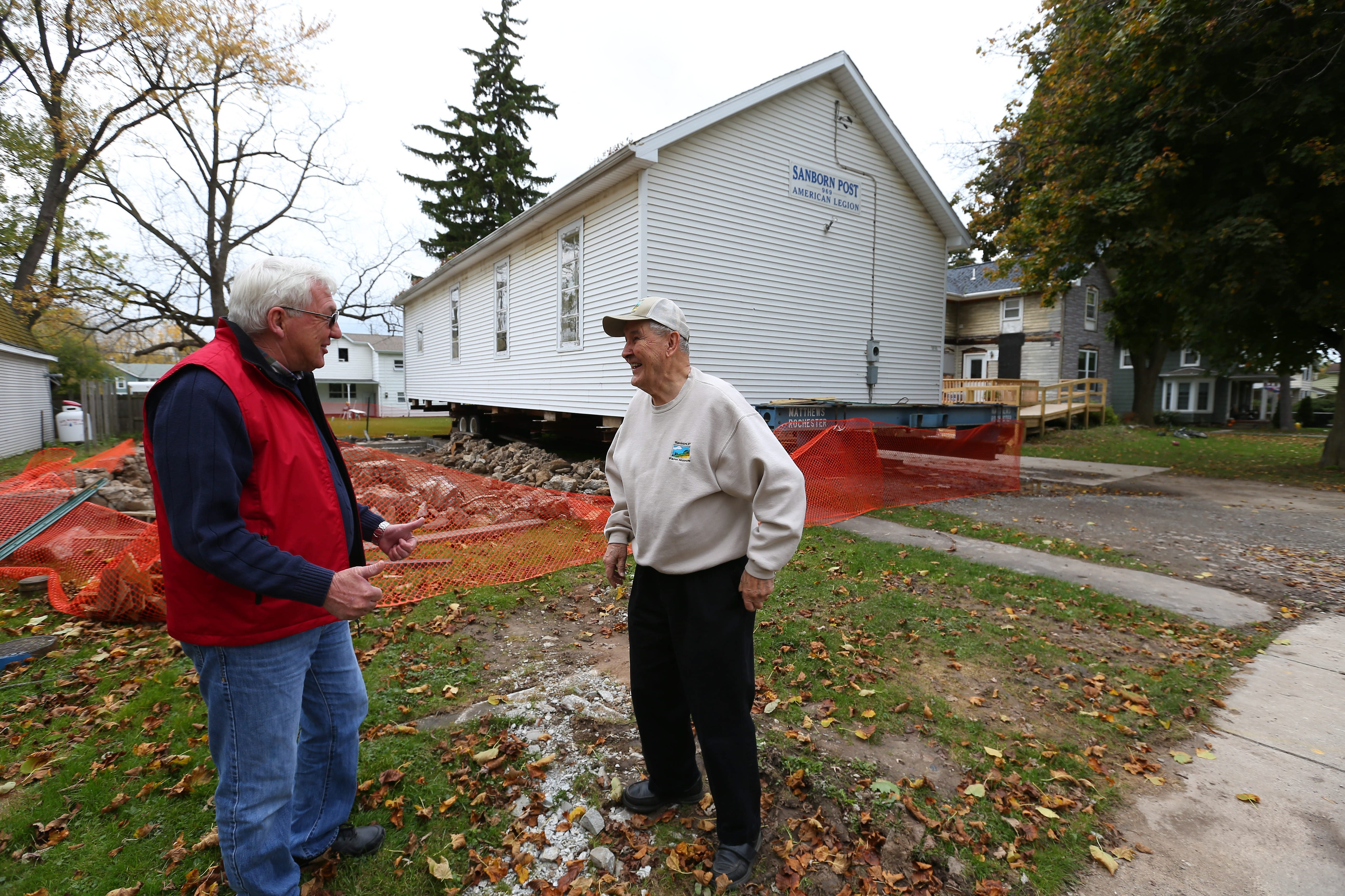 Bill Sterner and Gerry Treichler, right, are leading an ambitious plan to move a 189-year-old building to the Sanborn-Lewiston Farm Museum. The building has served as home to a number of churches and more recently the Sanborn post of the American Legion.
