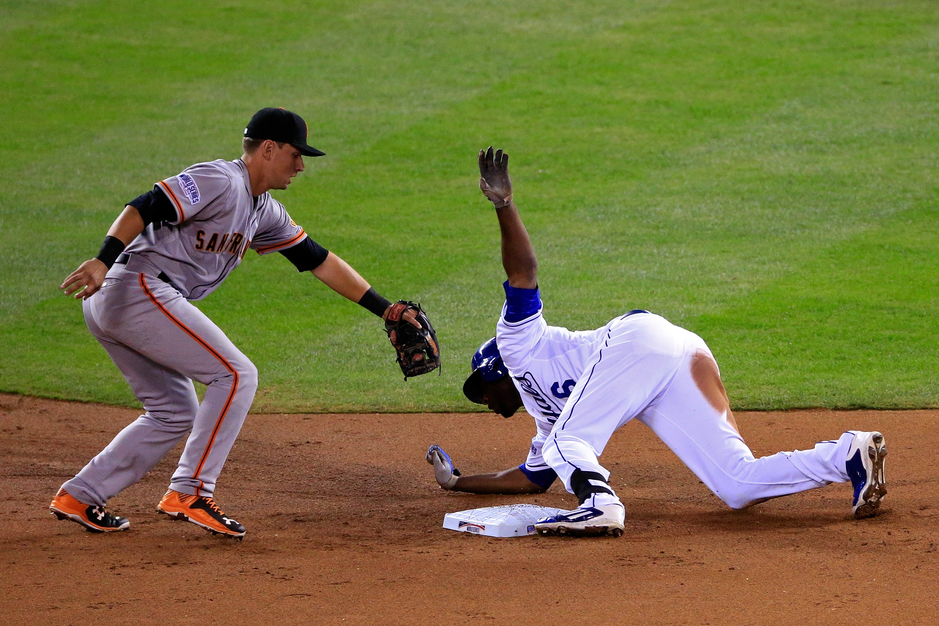 Giants second baseman Joe Panik tries to make a play against Lorenzo Cain of the Royals in Game Two on Wednesday night.
