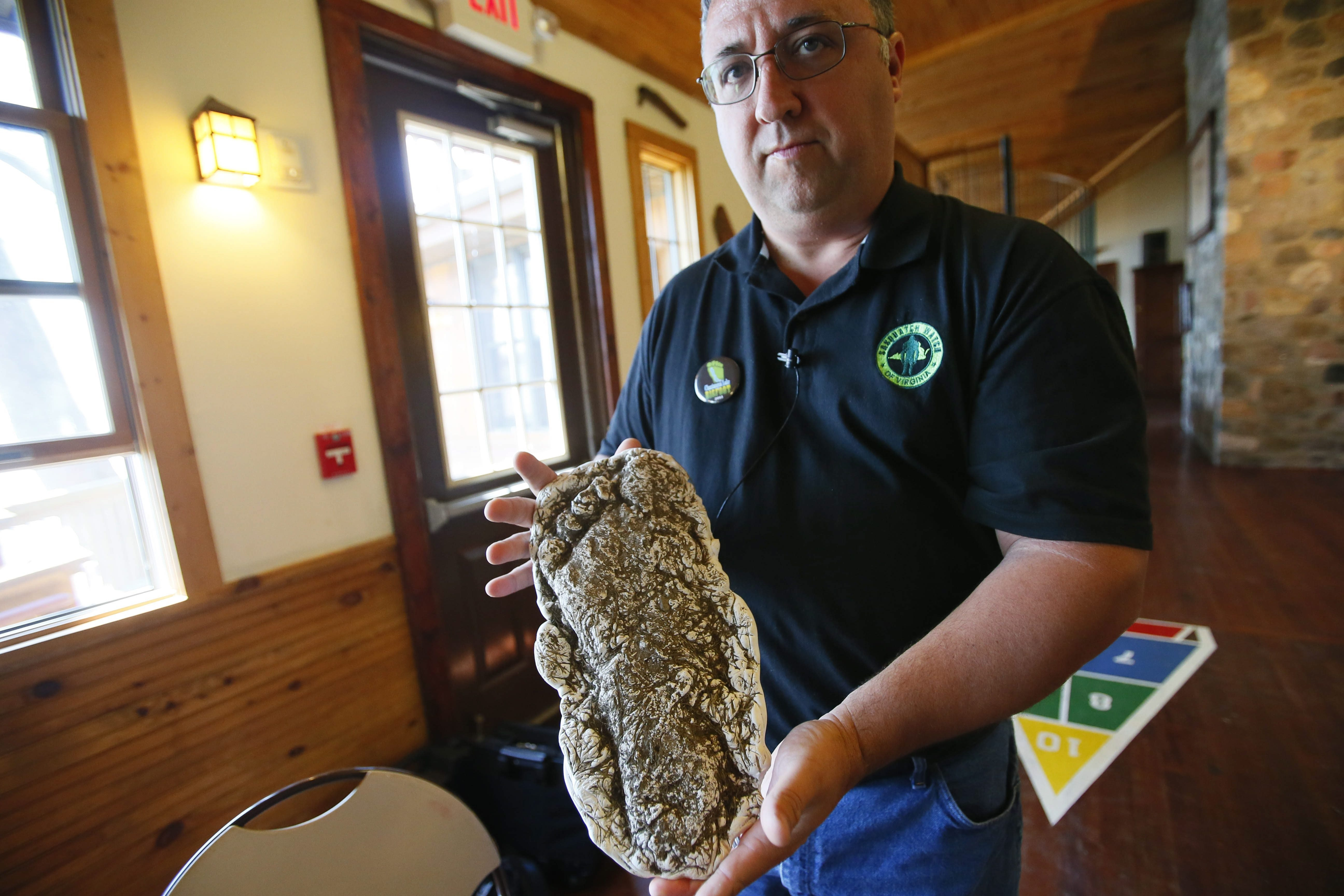 Billy Willard, director of Sasquatch Watch of Virginia, shows off a cast of an extremely large footprint he found and displayed during the Chautauqua Lake Bigfoot Weedend and Expo at the YMCA Camp Onyahsa in Dewittville last year.