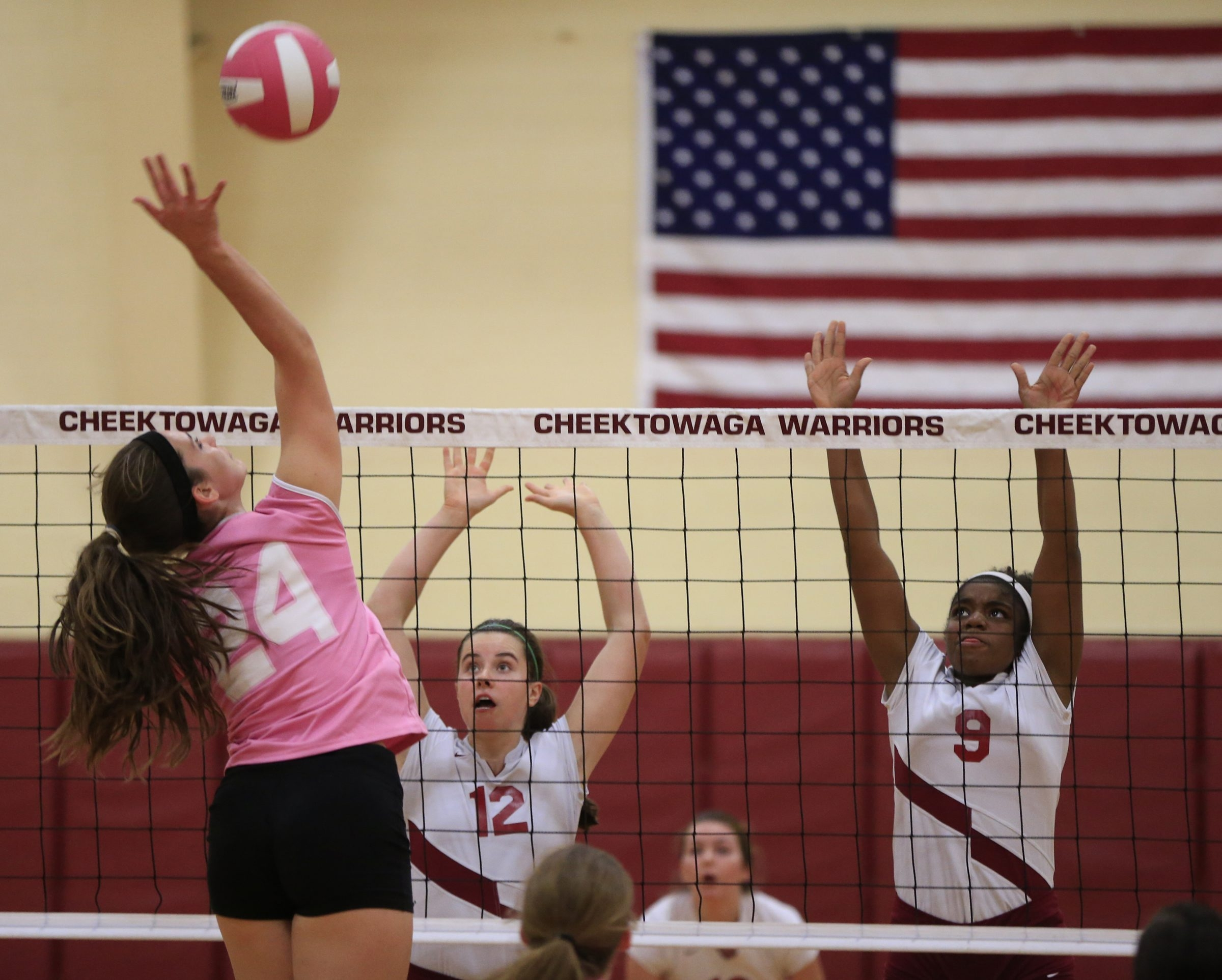 City Honors volleyball players Julia Panepinto (12) and Nashid Fulcher (9) attempt a block against Kalee Martin (24) of Cheektowaga.