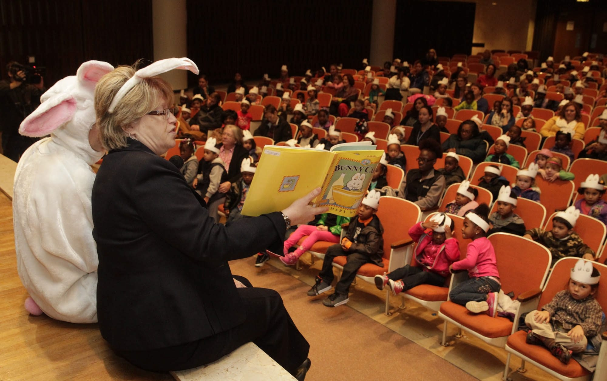 "Buffalo & Erie County Public Library Director Jean Jakubowski reads ""Bunny Cakes"" to pre-kindergartners from Bennett Park Montessori School on Monday."