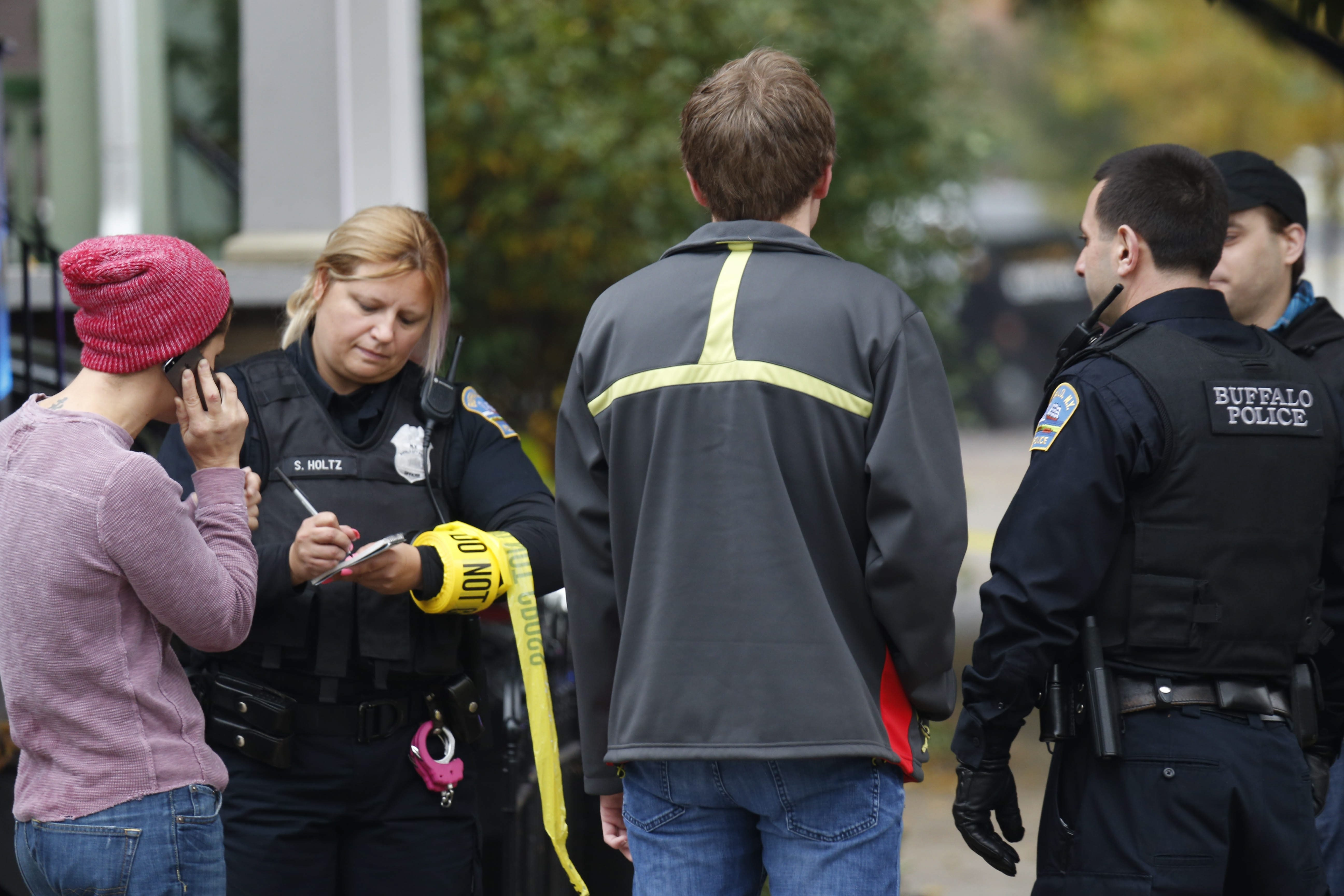 Buffalo Police officers interview neighbors as they investigate on College Street in Allentown where an apparent murder-suicide occurred, Tuesday, Oct. 21, 2014.  (Derek Gee/Buffalo News)