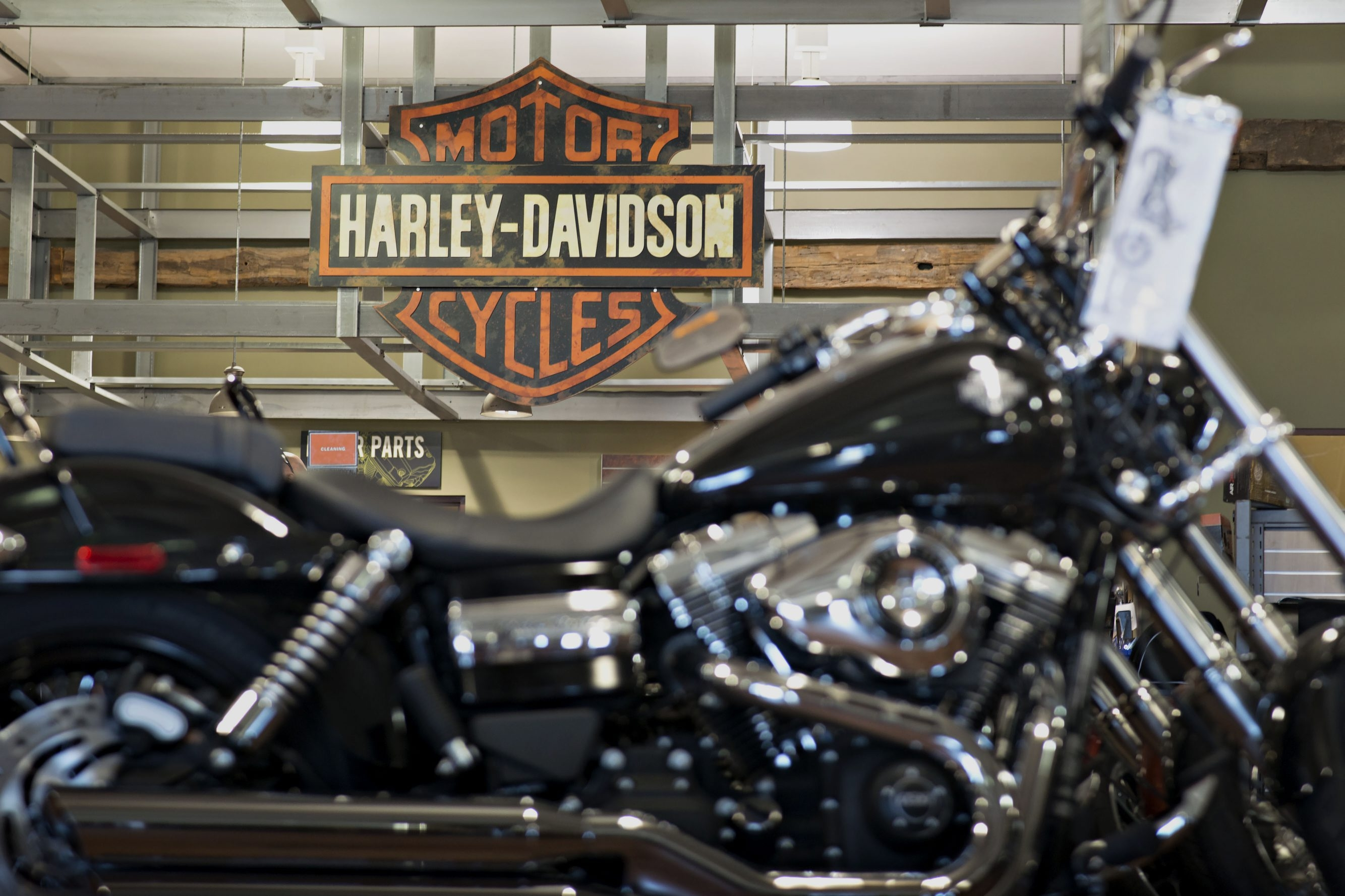 A 2014 Harley-Davidson Wide Glide motorcycle sits on display at the Starved Rock Harley-Davidson dealership in Ottawa, Illinois, U.S., on Tuesday, April 22, 2014. Harley-Davidson Inc. rose the most in almost 18 months after reporting first-quarter profit that topped analysts' estimates as retail sales of motorcycles increased. Photographer: Daniel Acker/Bloomberg