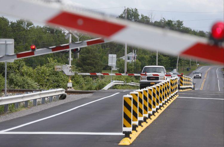 A vehicle waits at a rail crossing on Rogers Road.  (Robert Kirkham/Buffalo News)