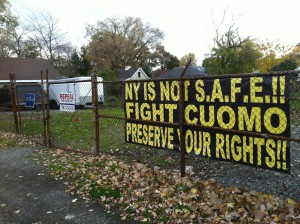 The City of Niagara Falls has determined this large, anti-Andrew Cuomo sign on a fence on a 79th Street property does not violate city ordinances. (Aaron Besecker/staff)