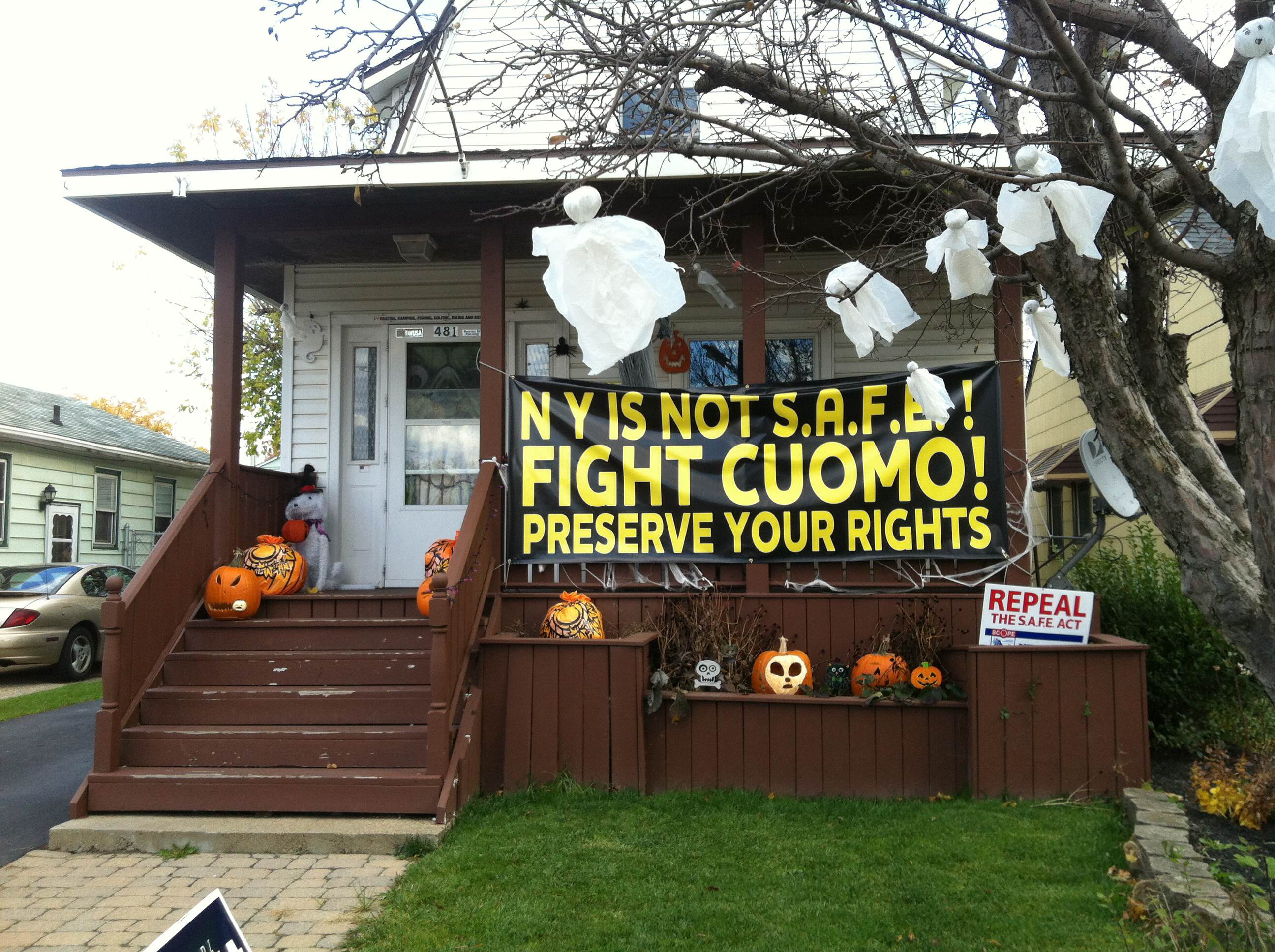 The City of Niagara Falls has determined that two large, anti-Andrew Cuomo signs, including this one in front of a house on Hyde Park Boulevard, do not violate any city ordinances. (Aaron Besecker/staff)