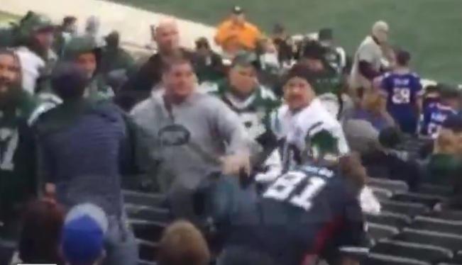 A Jets fan levels a Bills fan during Sunday's Buffalo victory.