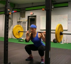 Karen Makar works out in her new gym, CrossFit Nickel City, at Virginia and 10th streets.