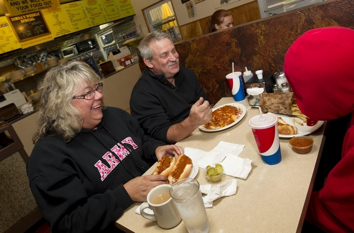 Lisa and Mark Peters have been eating in Zorba's Texas Hots for decades. Here, they have dinner with their son, Devin. (Sharon Cantillon/Buffalo News)