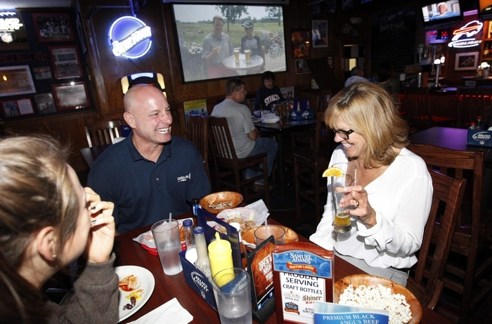 Audrey Weiss, left, enjoys wings with her parents, Jeff and Beth Weiss, in Buffalo Sports Grill in Hamburg. (Photos by Sharon Cantillon/Buffalo News)