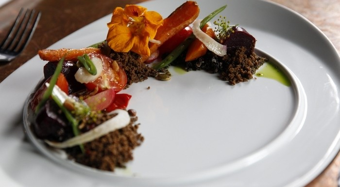 Assortment of local produce is anchored in eggplant; and made with fresh roasted and pickled vegetables, seeds and yogurt. (Sharon Cantillon/Buffalo News file photo)