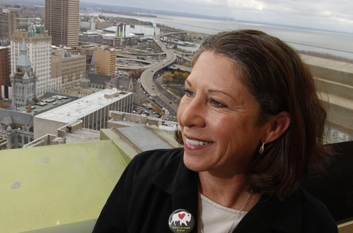 Buffalo Citybration is organizing an event to welcome home folks coming back to town for Thanksgiving.  It will be on the 25th and 28th floors of City Hall, where guests can see the wonderful changes to Buffalo.  Executive Director Marti Gorman views some of the sights from the observation deck that she will be pointing out to guests, Wednesday, Nov. 12, 2014.  (Sharon Cantillon/Buffalo News) (Sharon Cantillon/Buffaalo News)