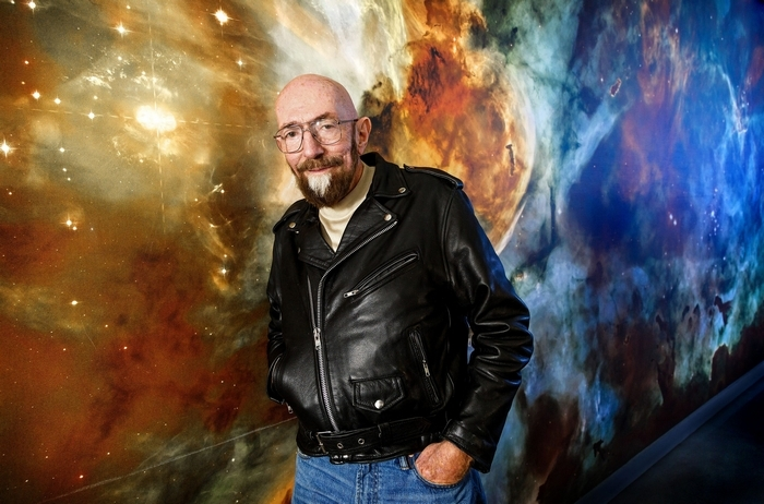 Astrophysicist Kip Thorne poses in front of a stellar mural at the California Institute of Technology's Cahill Center for Astronomy and Astrophysics in Pasadena, Calif., where Thorne has his office. (Los Angeles Times)