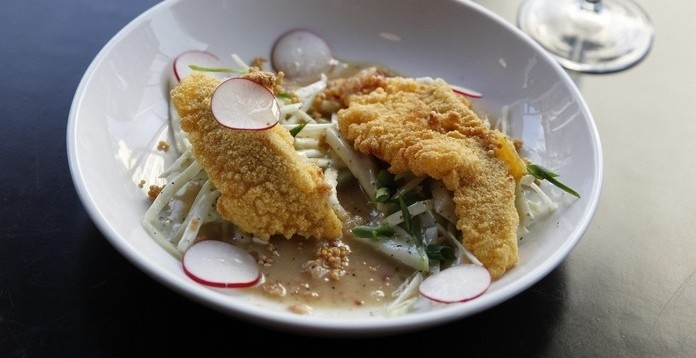 The cornmeal-fried catfish from Oshun is served with a bacon vinaigrette and chayote slaw. (Sharon Cantillon/Buffalo News file photo)