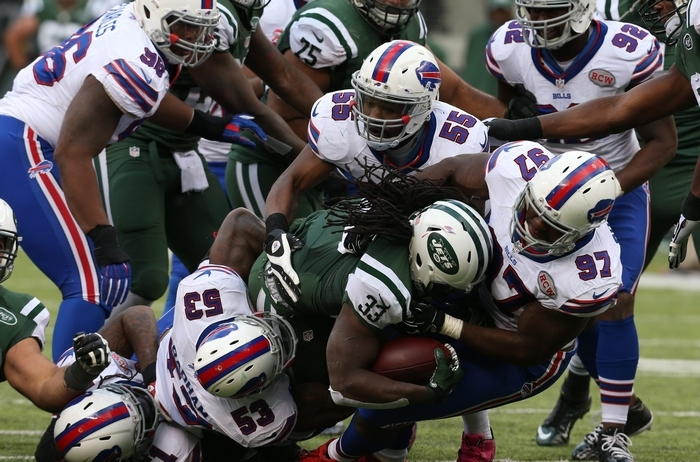 Corbin Bryant  (97) and a gang of Bills tacklers take down Jets running back Chris Ivory for a loss in the second quarter. The Jets  ran for 175 yards but had six turnovers.