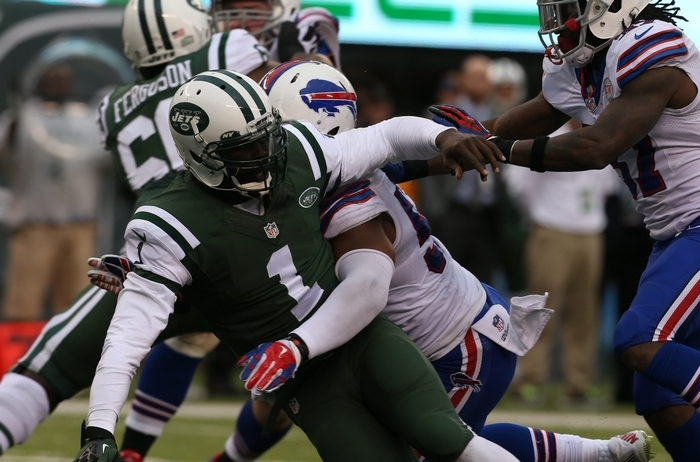 Bills linebacker Preston Brown hits Jets quarterback Michael Vick in the third quarter Sunday. (James P. McCoy/Buffalo News)