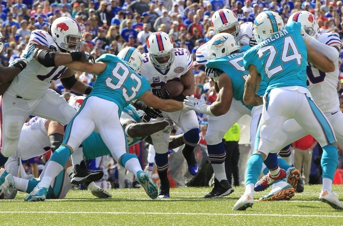 Buffalo Bills running back Fred Jackson (22) looks for the hole against Miami Dolphins during the third quarter at Ralph Wilson Stadium in Orchard Park, N.Y. on Sunday, Sept. 14, 2014. ()