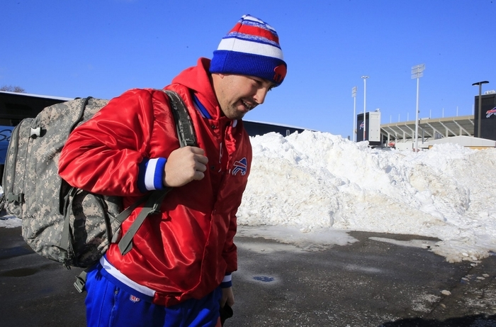 Quarterback Kyle Orton leaves Ralph Wilson Stadium to board a bus to the airport for a flight to Detroit. (Harry Scull Jr./Buffalo News)