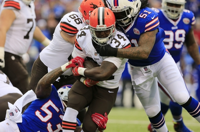 Browns running back Isaiah Crowell is tackled by Buffalo's Nigel Bradham, left, and Brandon Spikes. Crowell had just 29 rushing yards. (Harry Scull Jr./Buffalo News)