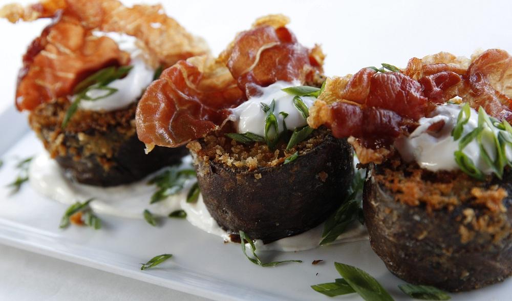 The potato skins small plate at Bacchus features Gorgonzola, green onion and crispy prosciutto. (Sharon Cantillon/Buffalo News file photo)
