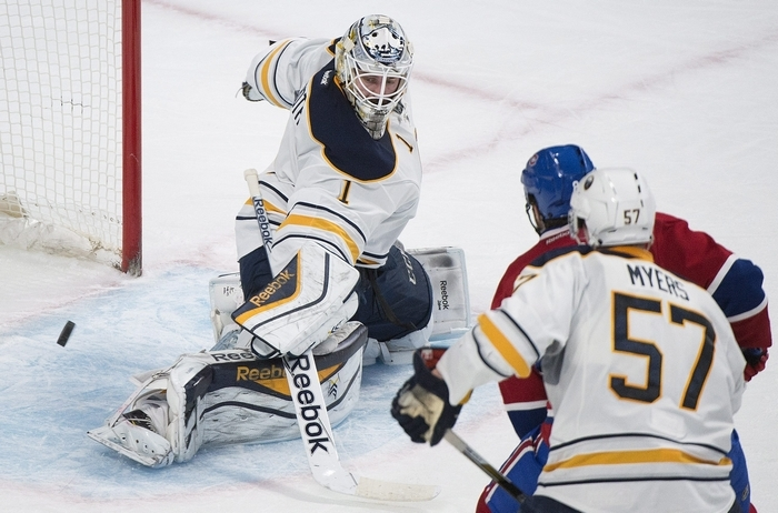 Buffalo Sabres goaltender Jhonas Enroth makes a save against Montreal Canadiens' P.K. Subban  as Sabres' Tyler Myers and Canadiens' Brandon Prust look for the rebound during third period action in Montreal on Saturday. Enroth sparkled in goal, making 41 saves in Buffalo's 4-3 shootout victory. (AP Photo)