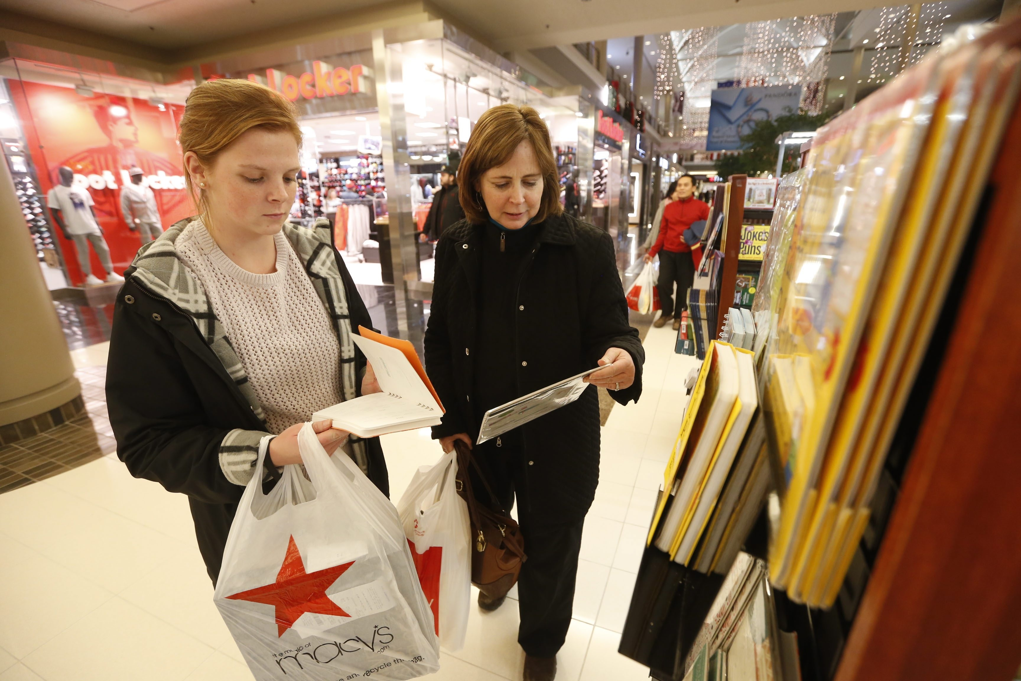 Meghan Wilcox, left, and her mom, Patti Service, shop at the Walden Galleria after an early Thanksgiving dinner.