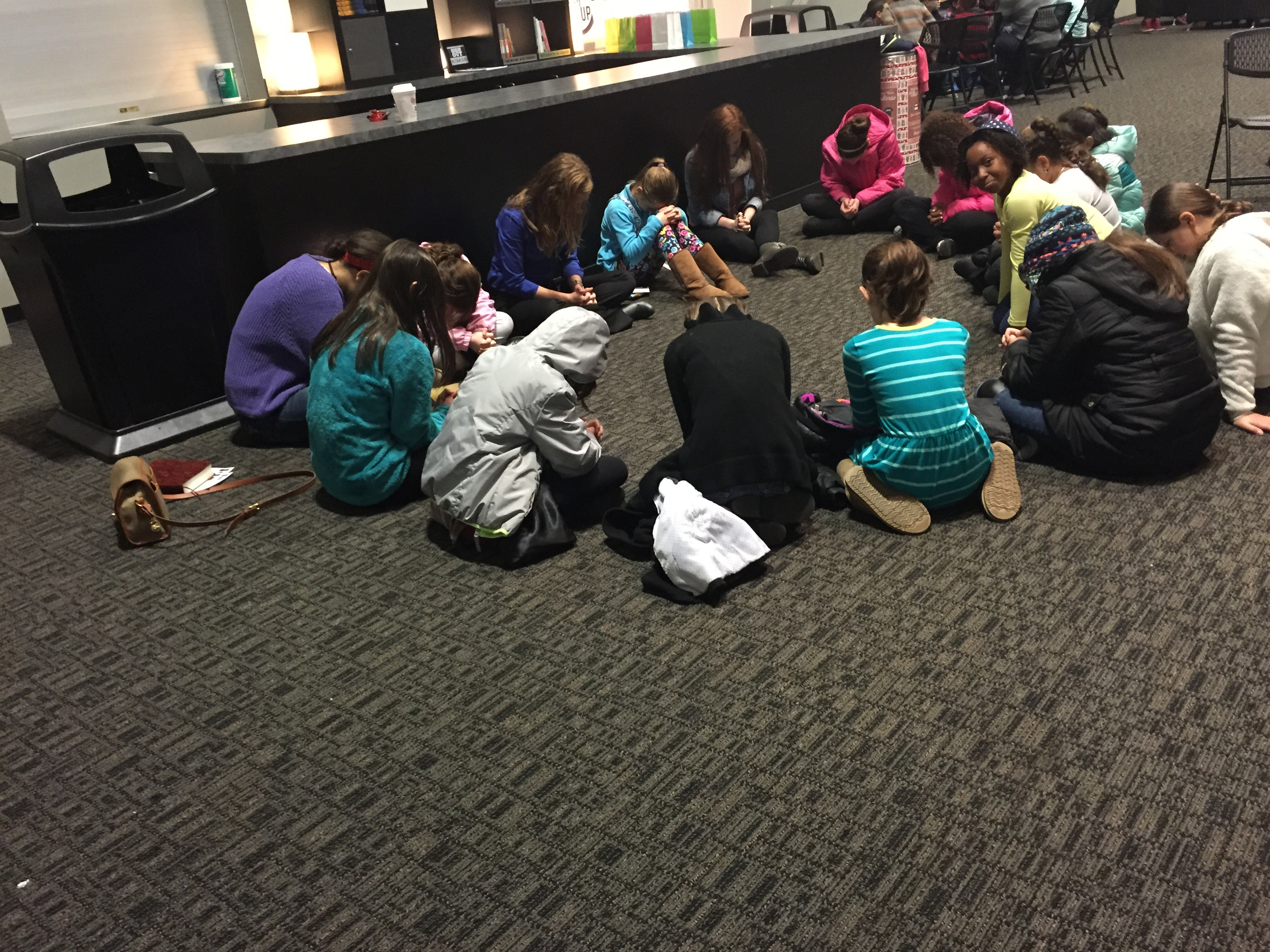 Raquelle Raugh leads a small group of fifth grade girls in SHINE, the middle school ministry at The Chapel.