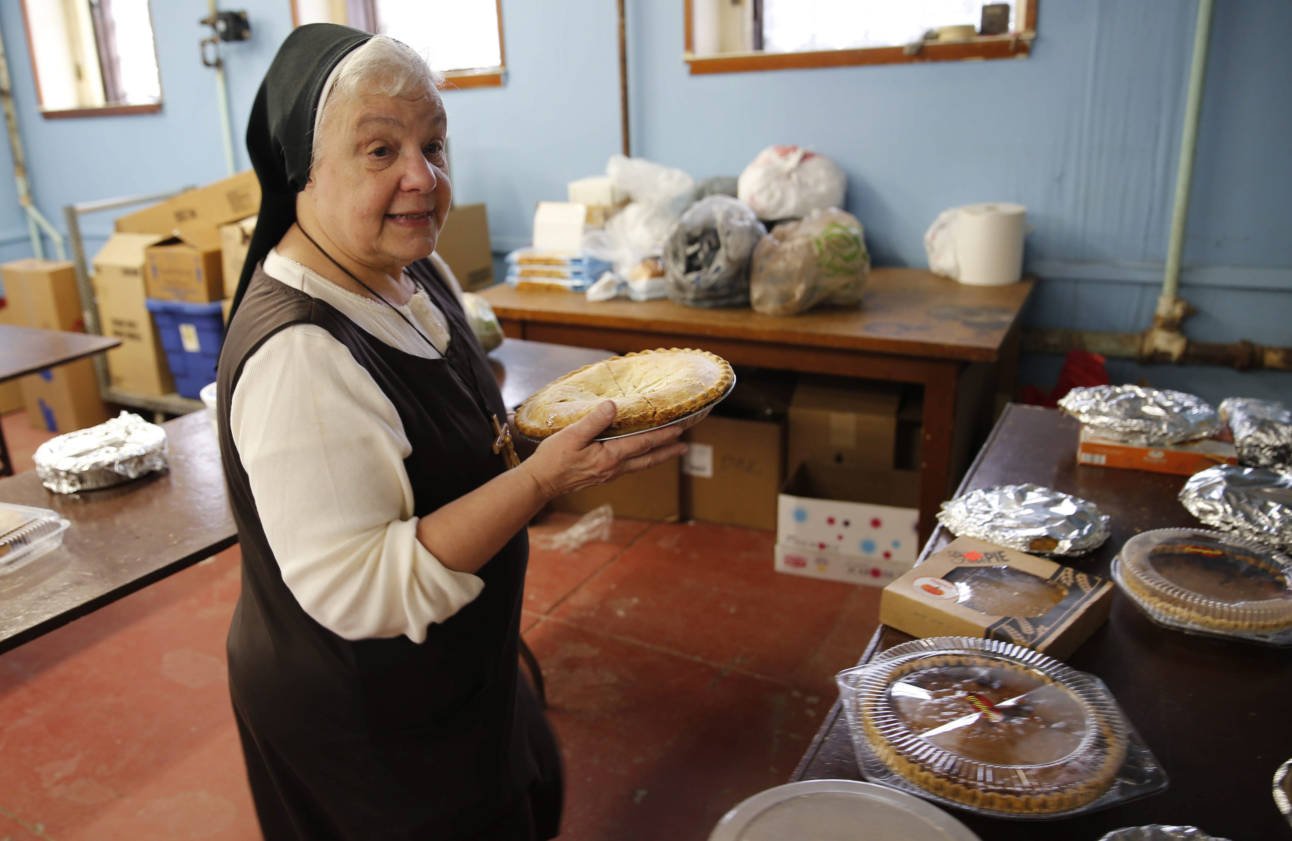 Sister Mary Johnice serves up pies at the 30th annual Thanksgiving dinner at the Response to Love Center on Thursday. Volunteers expected to serve between 200 and 300 holiday meals to people in need.