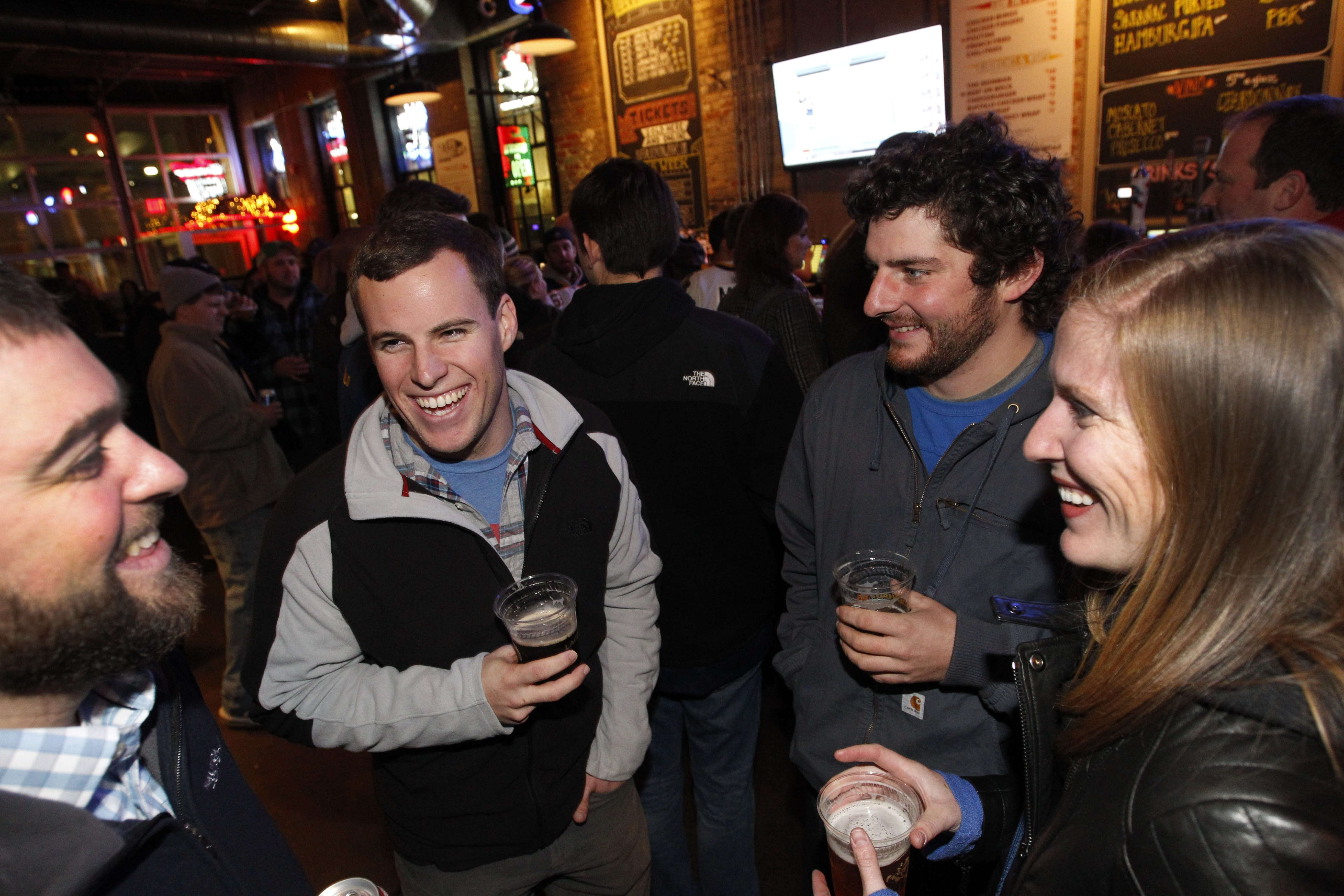 Grand Island native Chris Stessing, second from left, now in Washington D.C., parties at Buffalo Iron Works on Wed- nesday with brother Mike Dedario, left, friend Peter Costello of Youngstown and a cousin, Ashley Chassar of Lewiston.