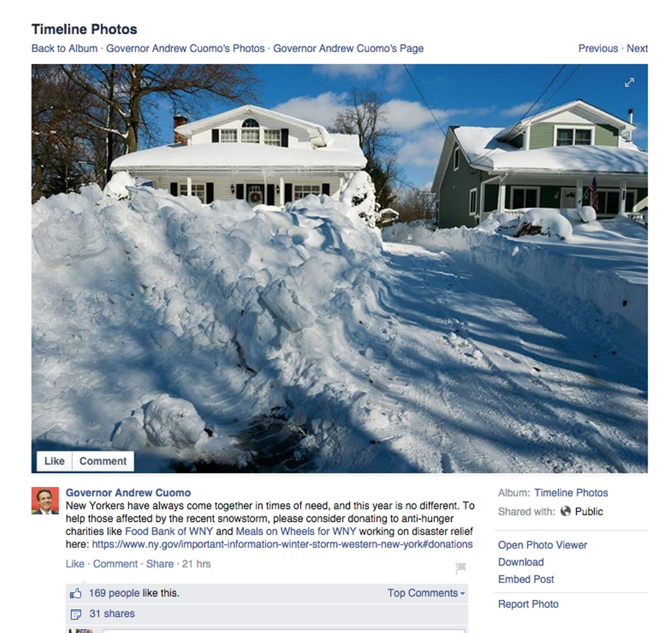 With a Facebook post that featured this photo, Gov. Andrew Cuomo urged New Yorkers to donate to anti- hunger charities helping in the snowstorm recovery. The South Buffalo house at the left is Carl Paladino's.