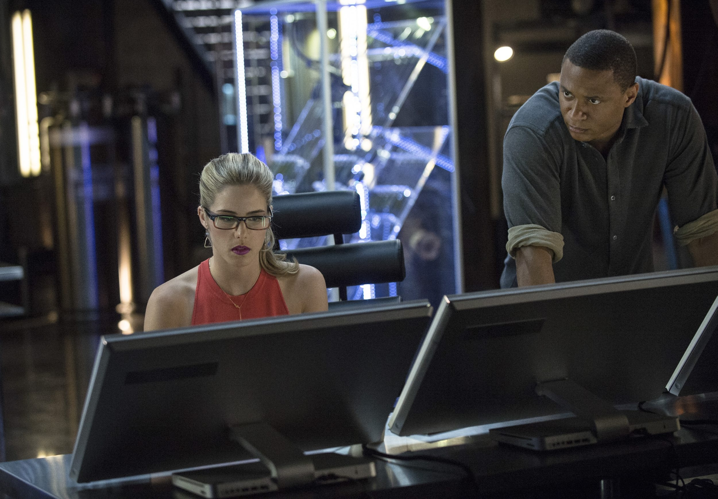 "Emily Bett Rickards as Felicity Smoak, left, and David Ramsey as John Diggle in ""Arrow,"" which airs at 8 p.m. Wednesdays on the CW."